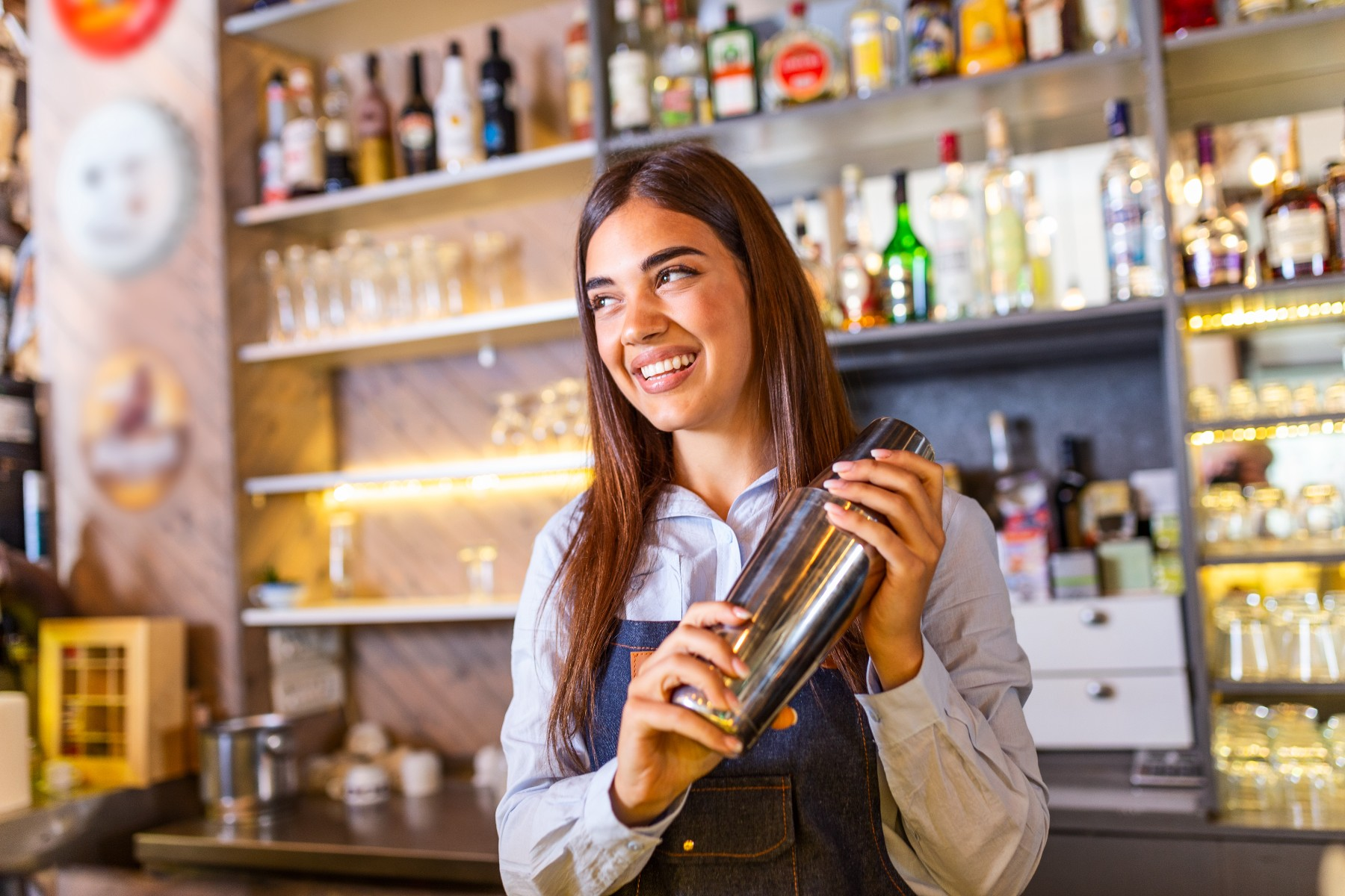 young woman service worker in Spain bar