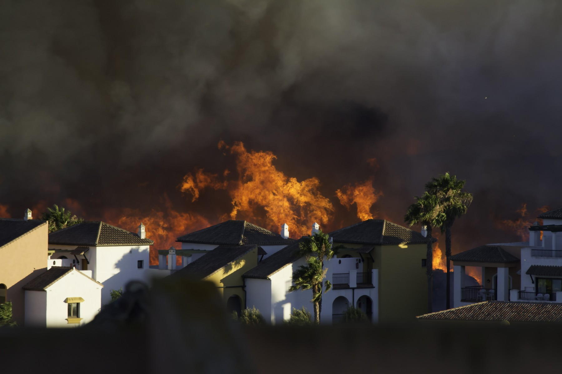 wildfire burns near homes in Spain