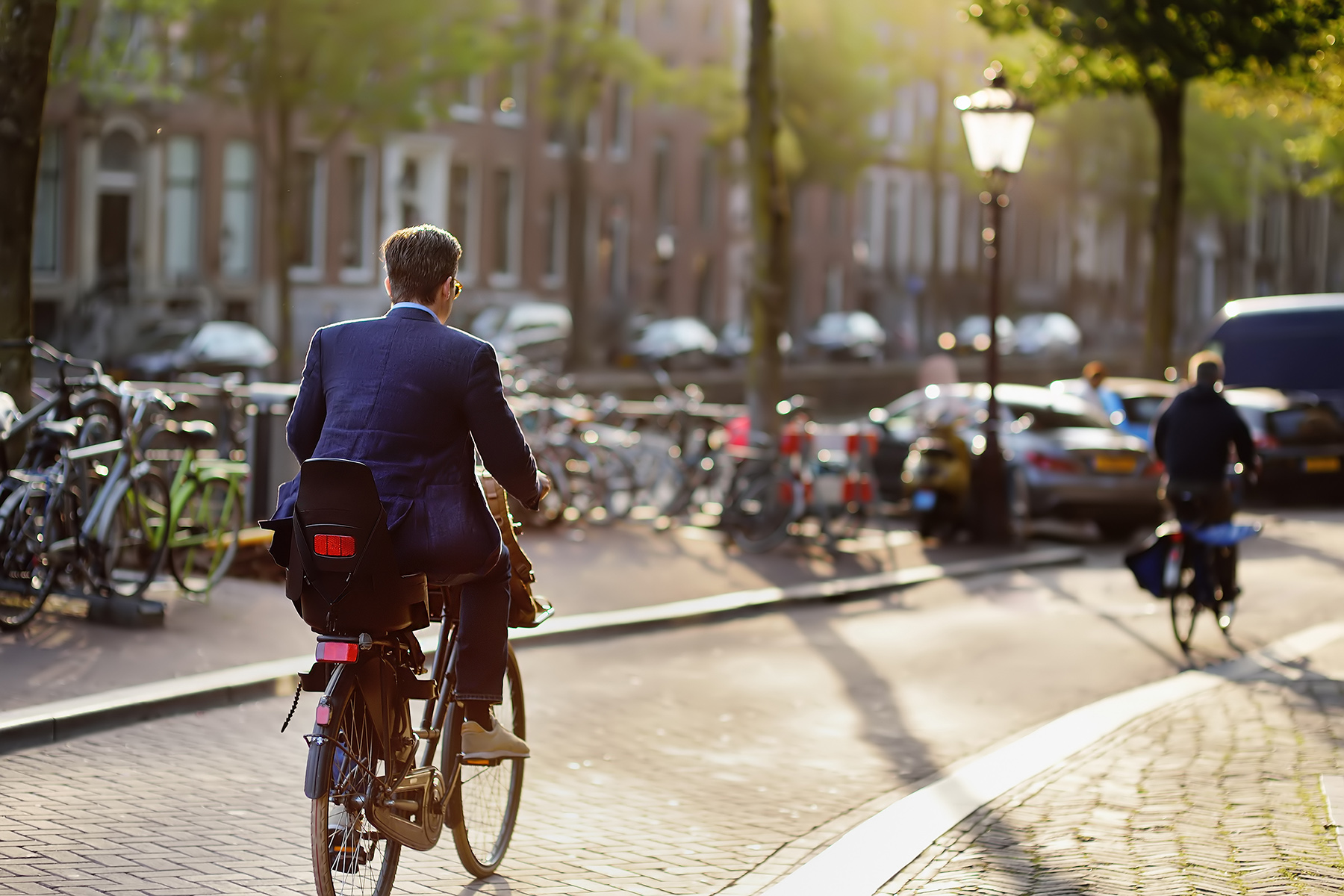Businessman on his bicycle in Amsterdam