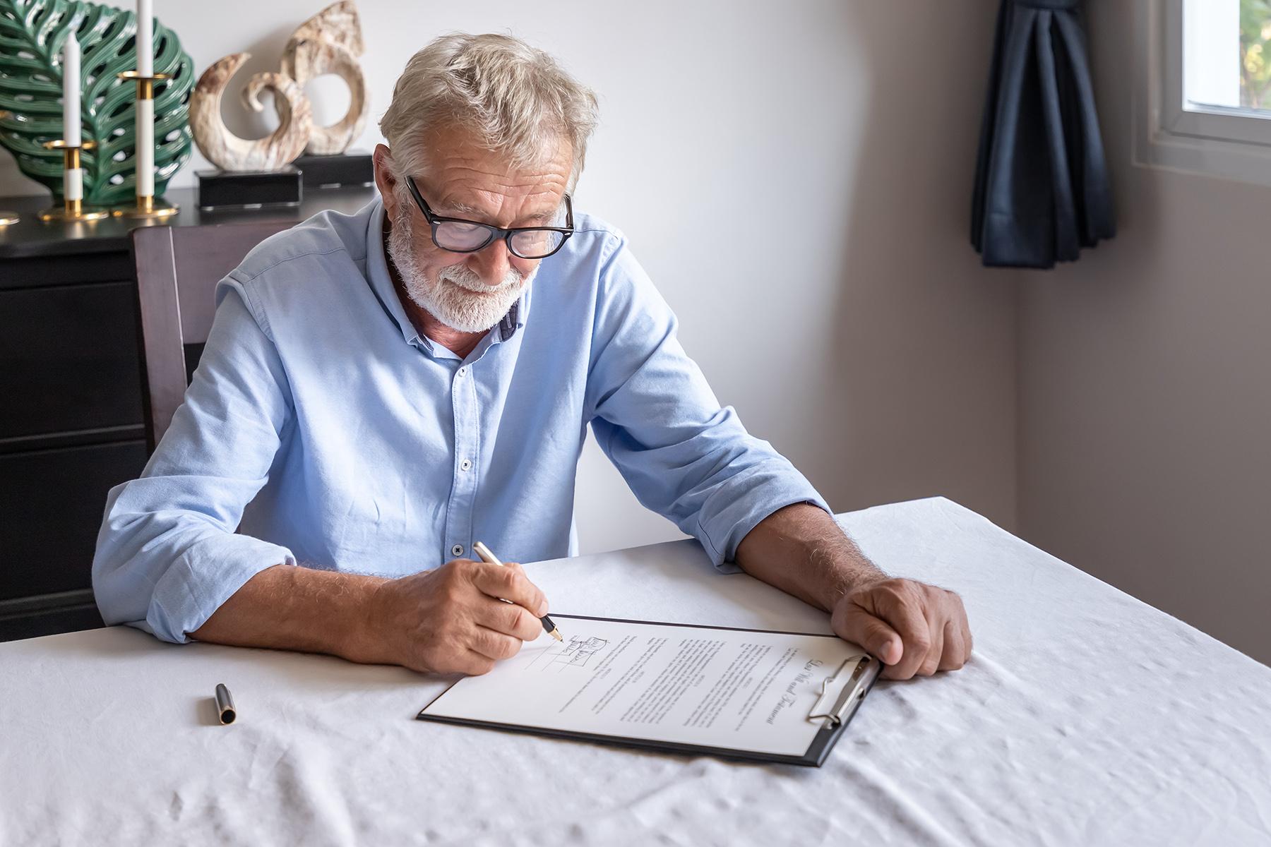 Senior man signing will
