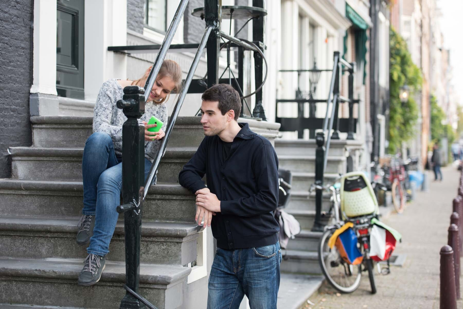 couple on phone Amsterdam