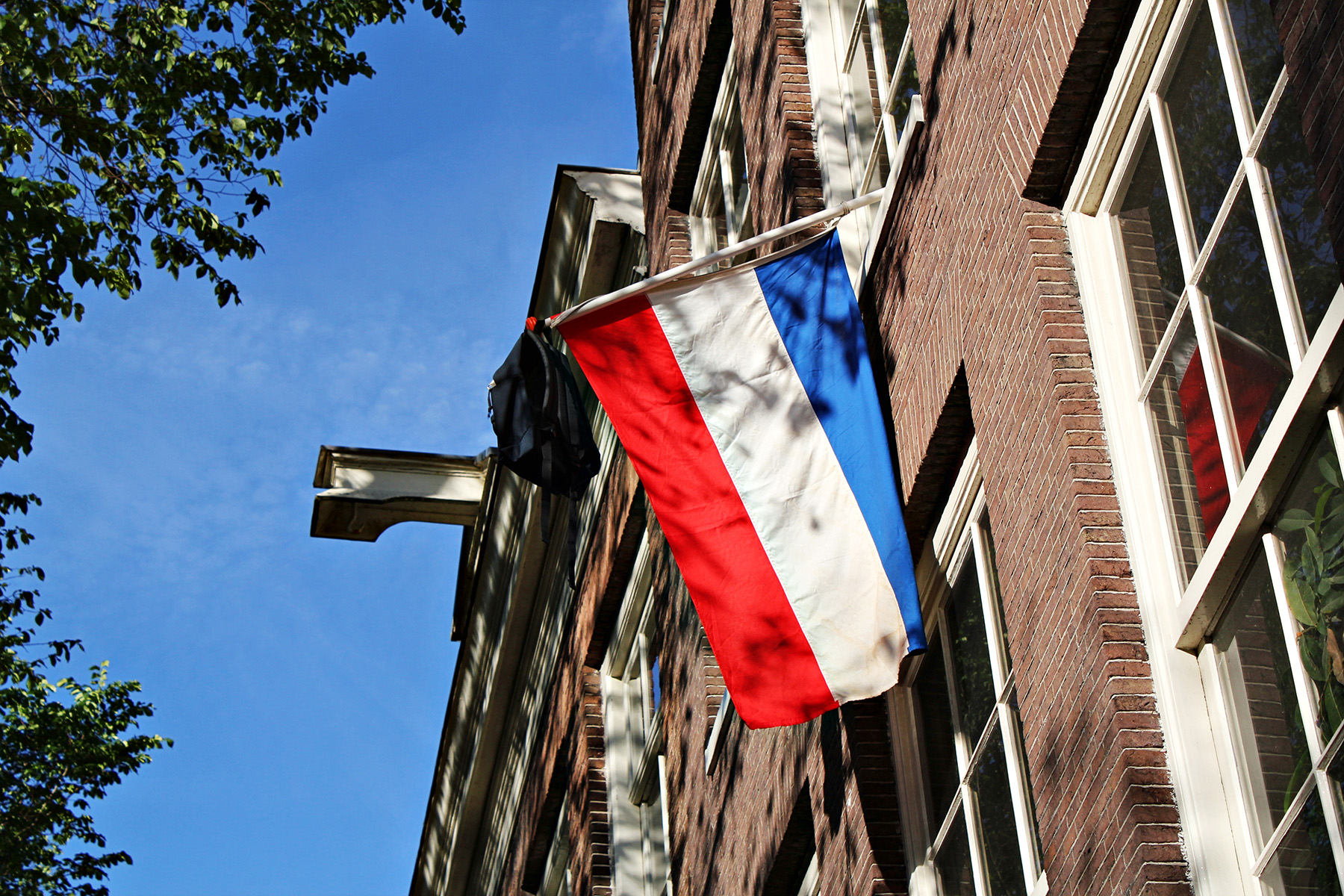 Students typically hang their backpack with a Dutch flag after completing their studies