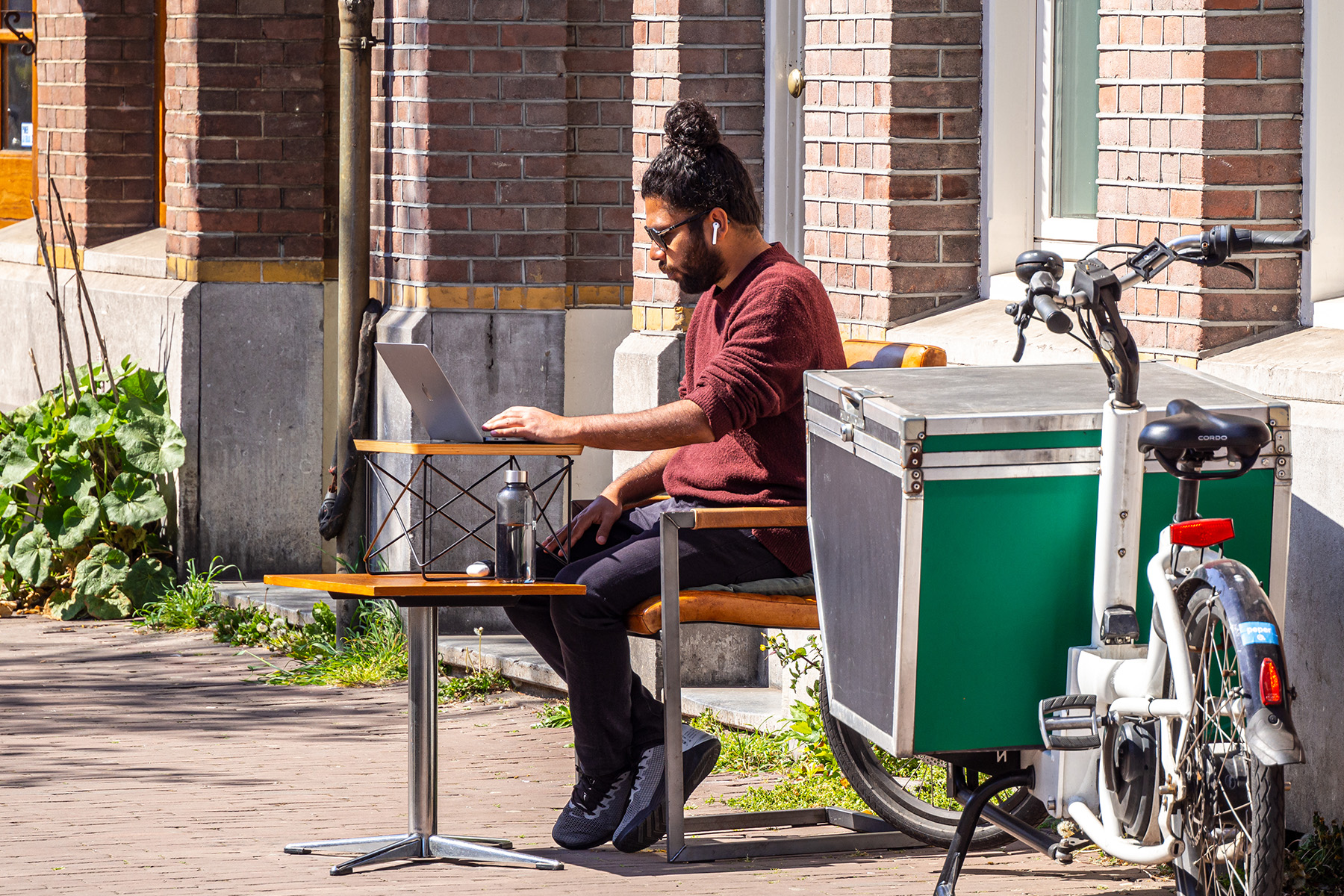 Freelancer working on his laptop in Amsterdam