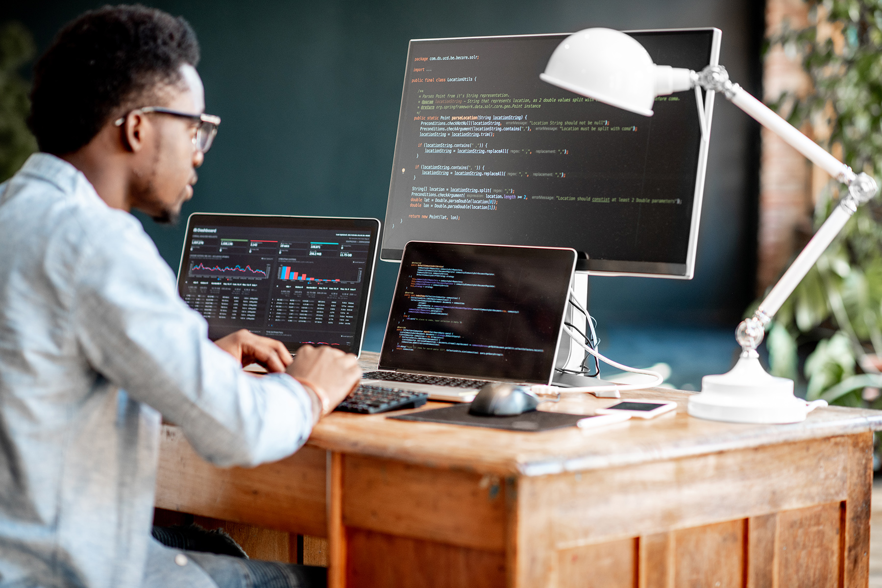 Programmer working at his home office