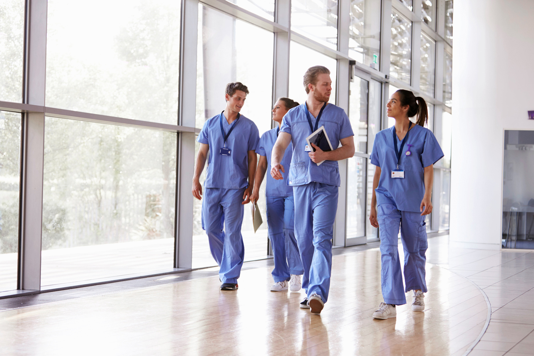 Medical staff walking through a hospital