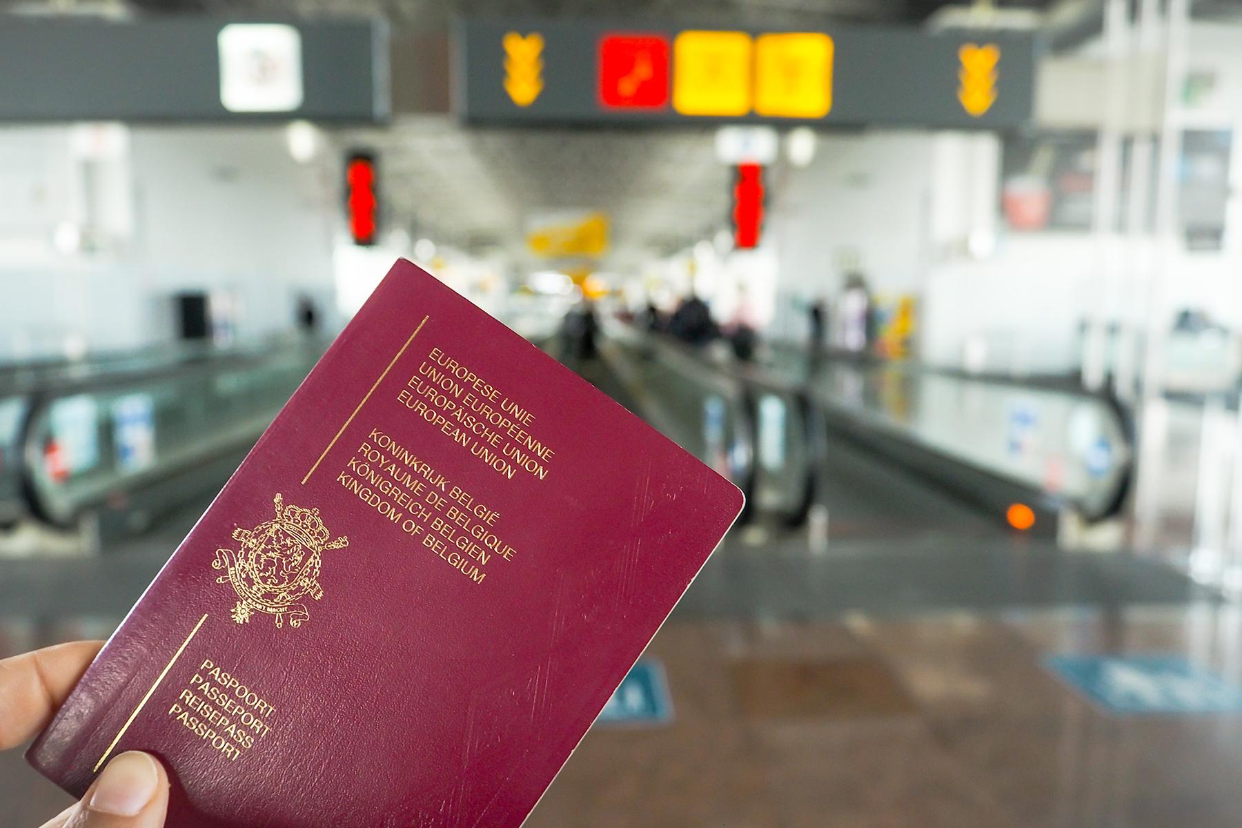 A Belgian passport at an airport