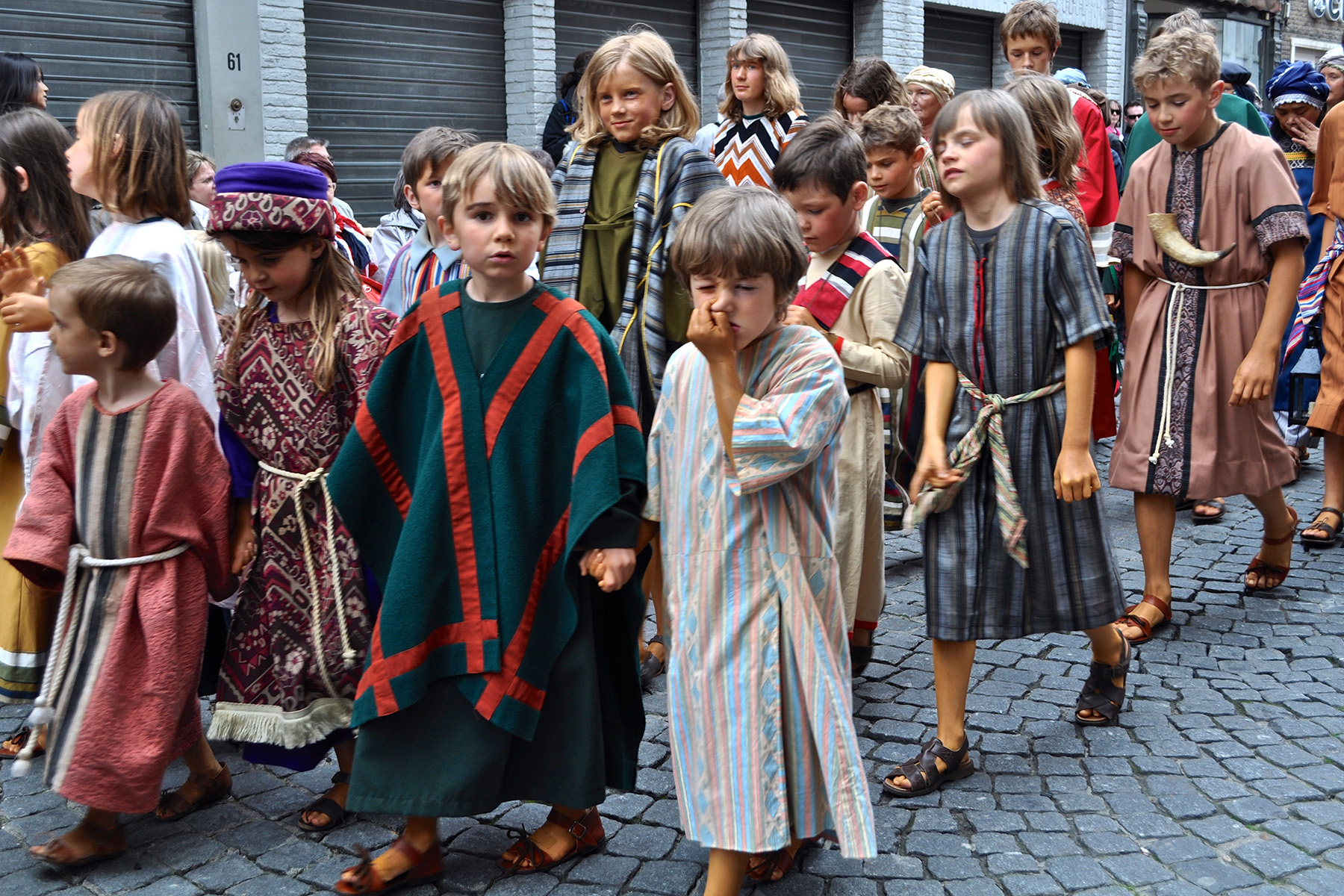 Kids participating in the Bloedprocessie in Brugge