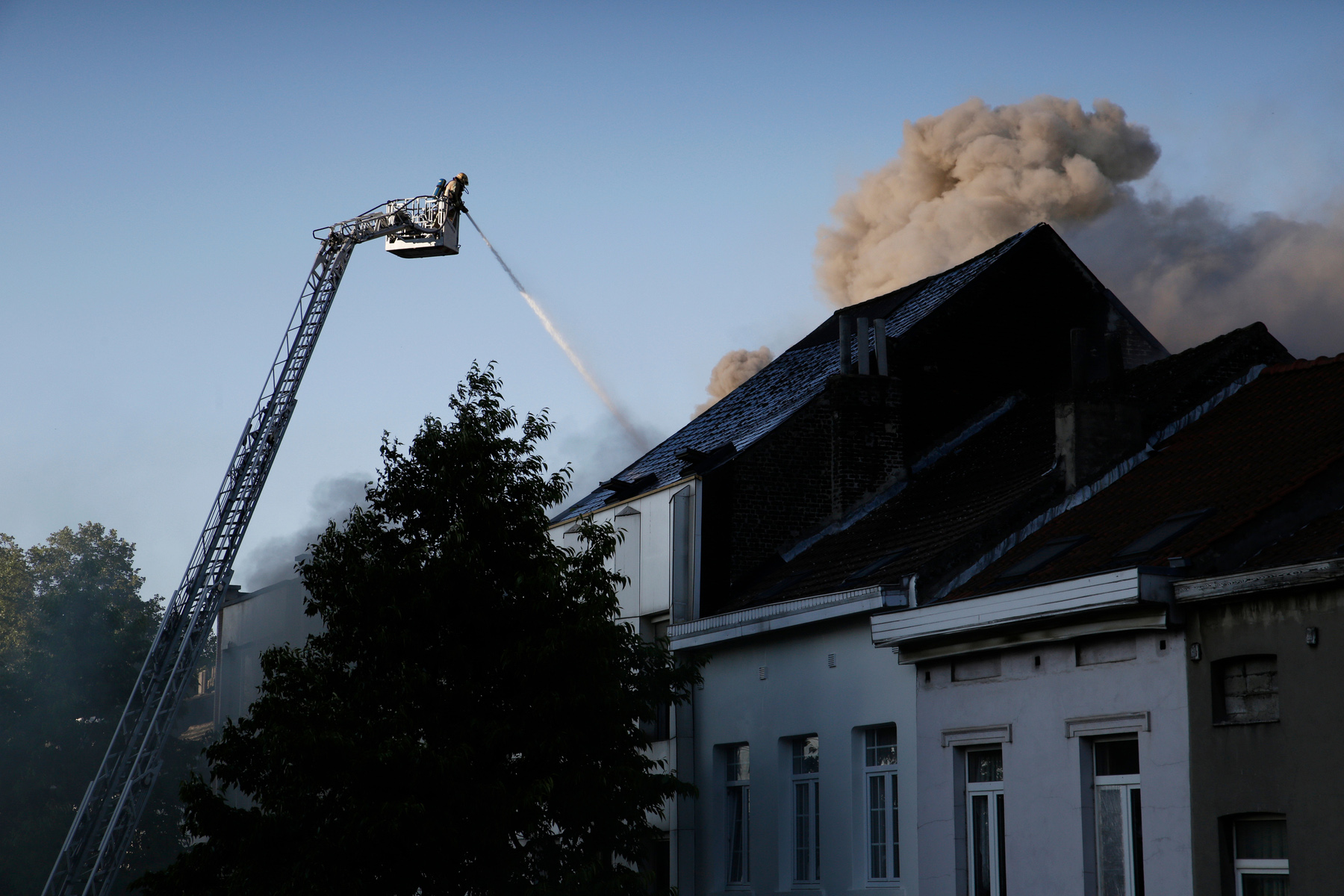 Firefighters responding to a house fire in Belgium