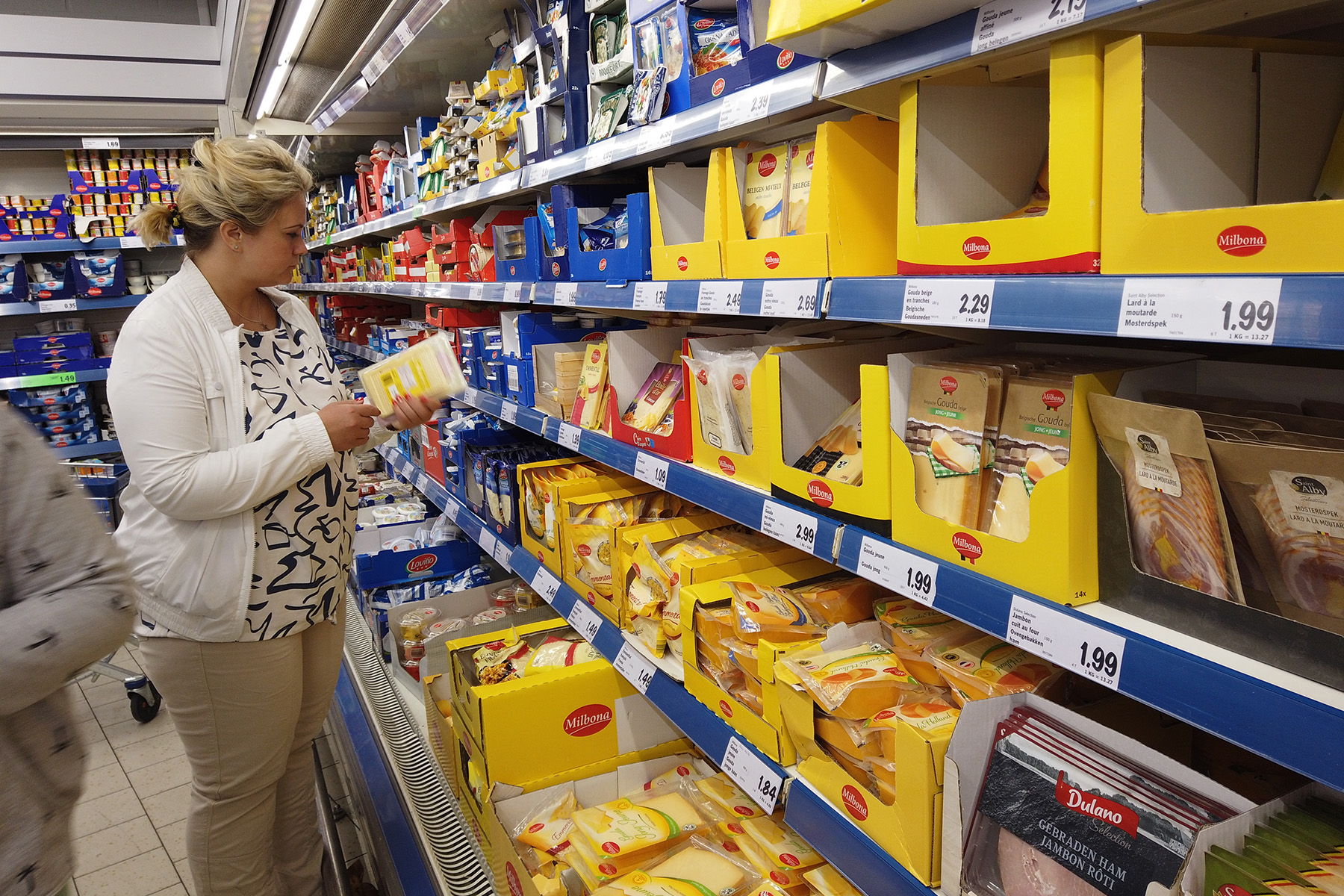 A woman shopping in a grocery store in Brussels