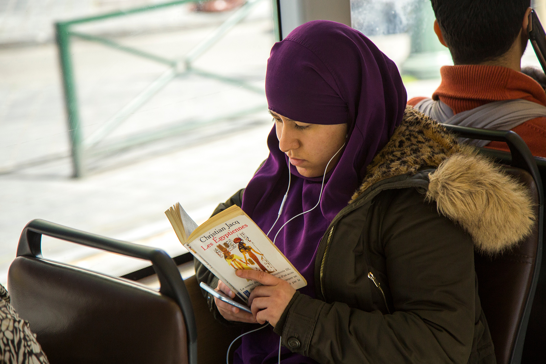 Muslim student reading a textbook