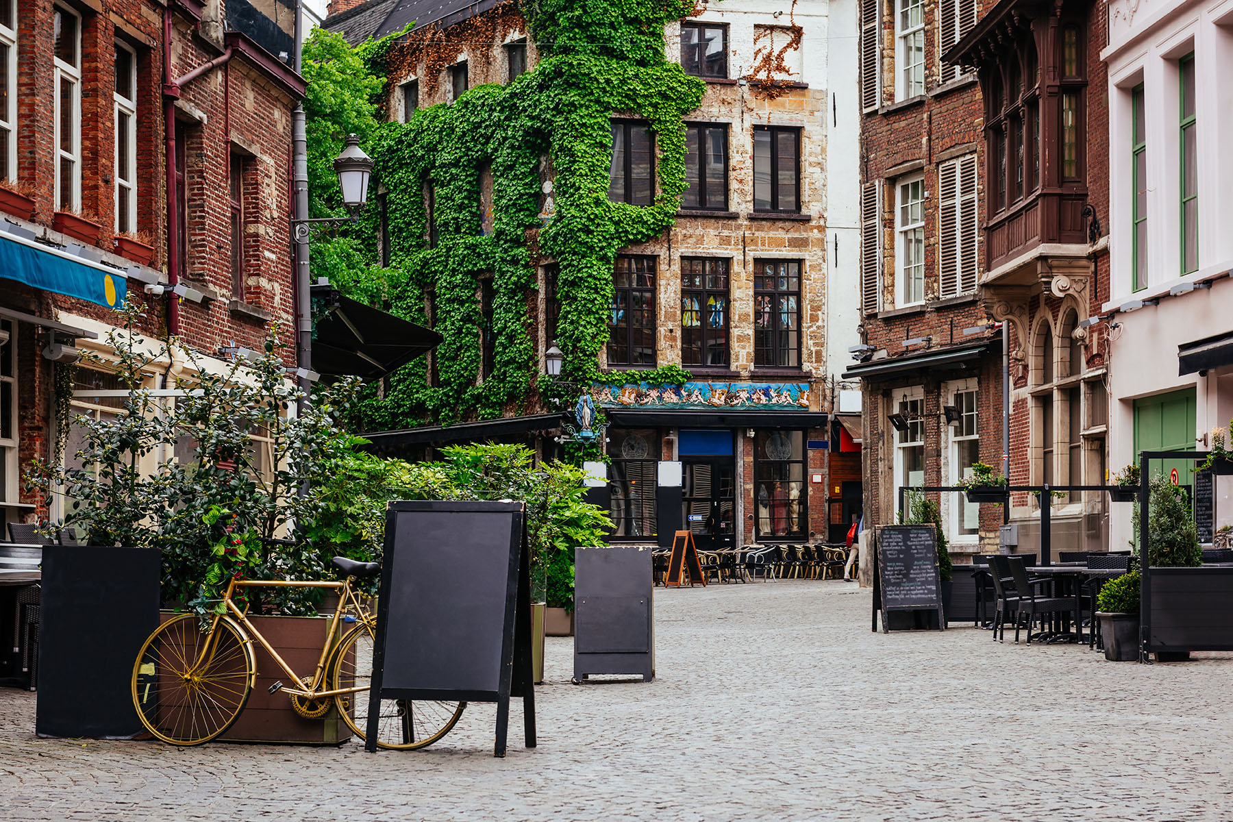 Typical old buildings with cafés and apartments in the city center of Antwerp
