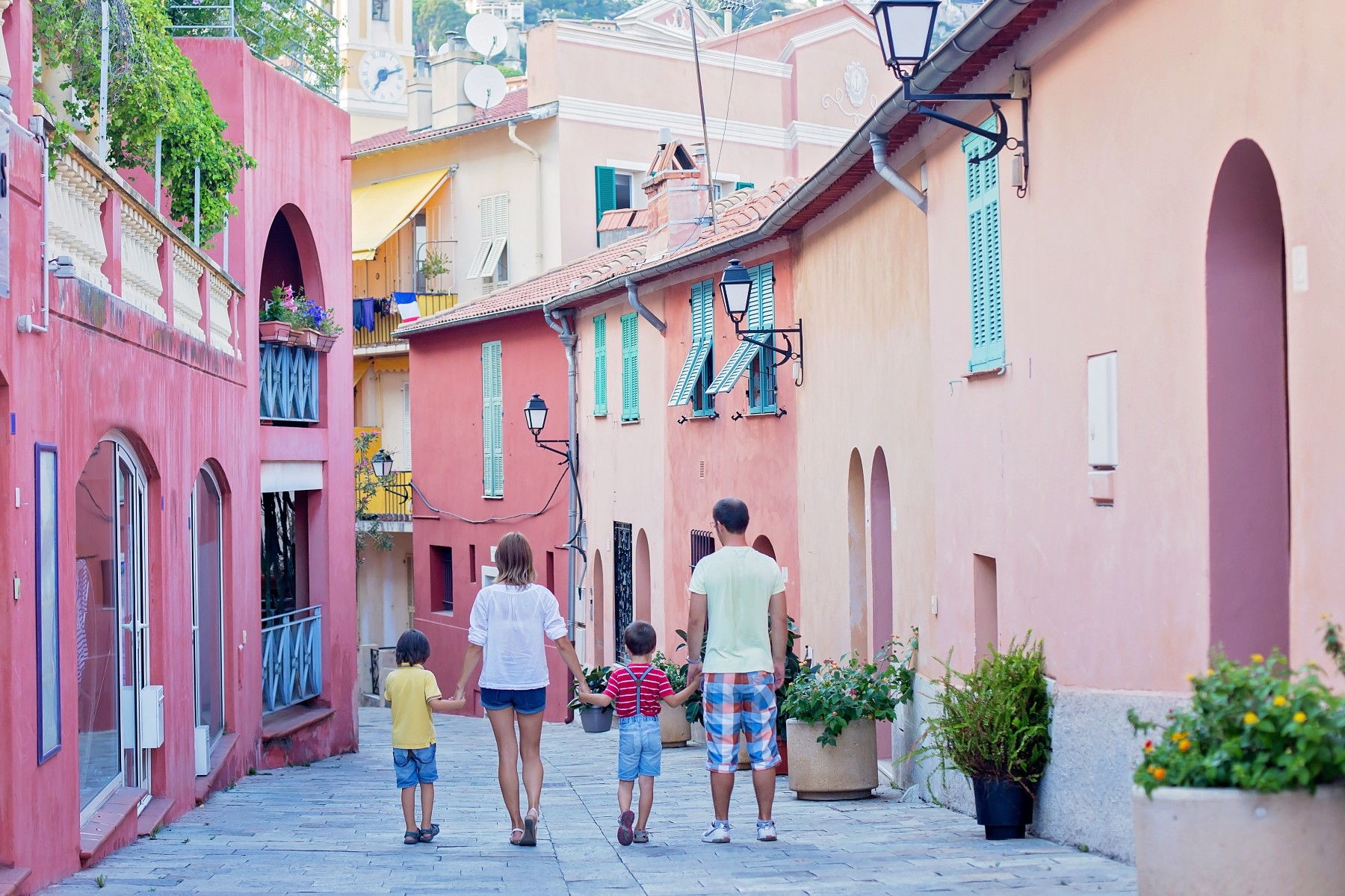 Family walking through a city center in France