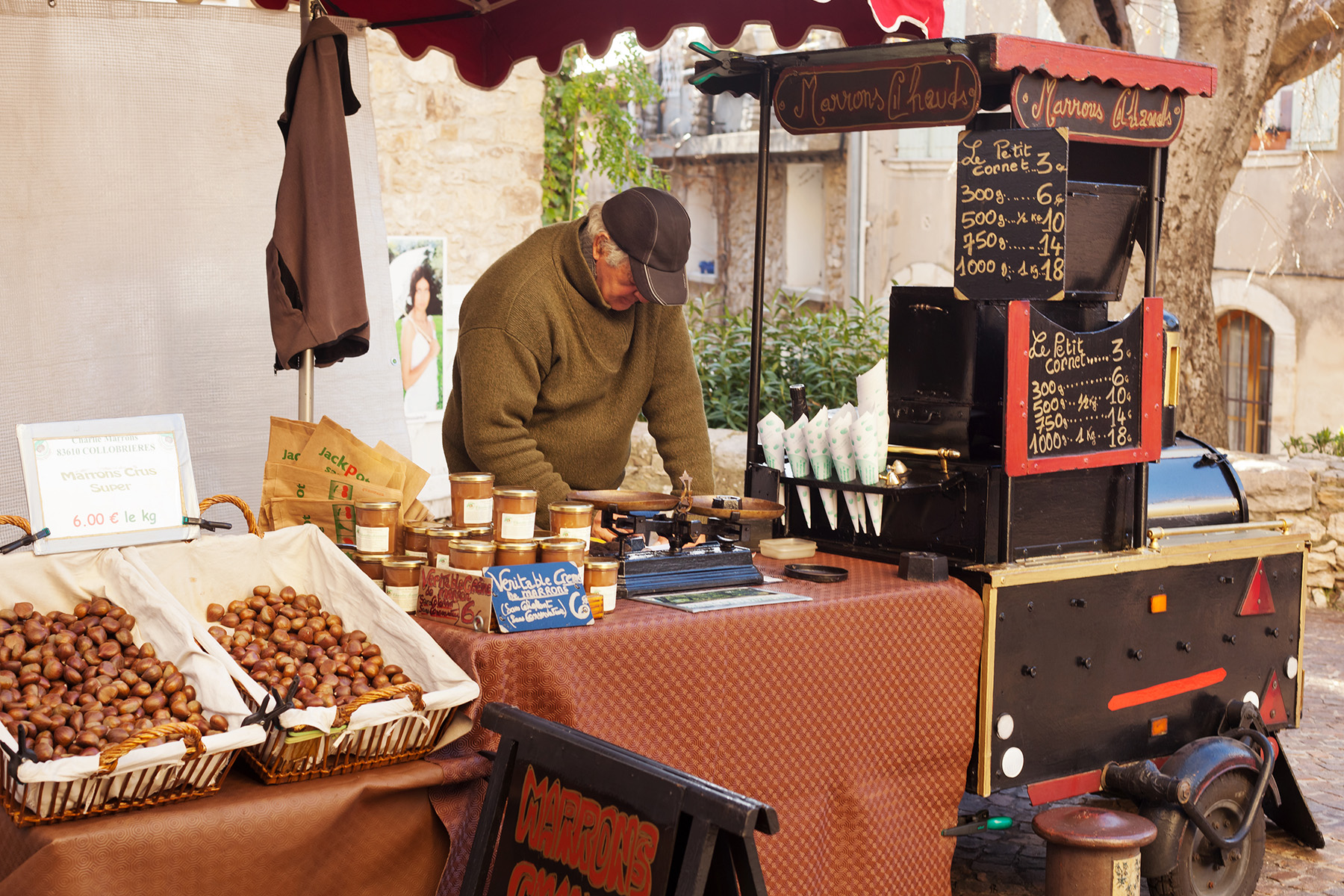 French entrepreneur selling roasted chestnuts