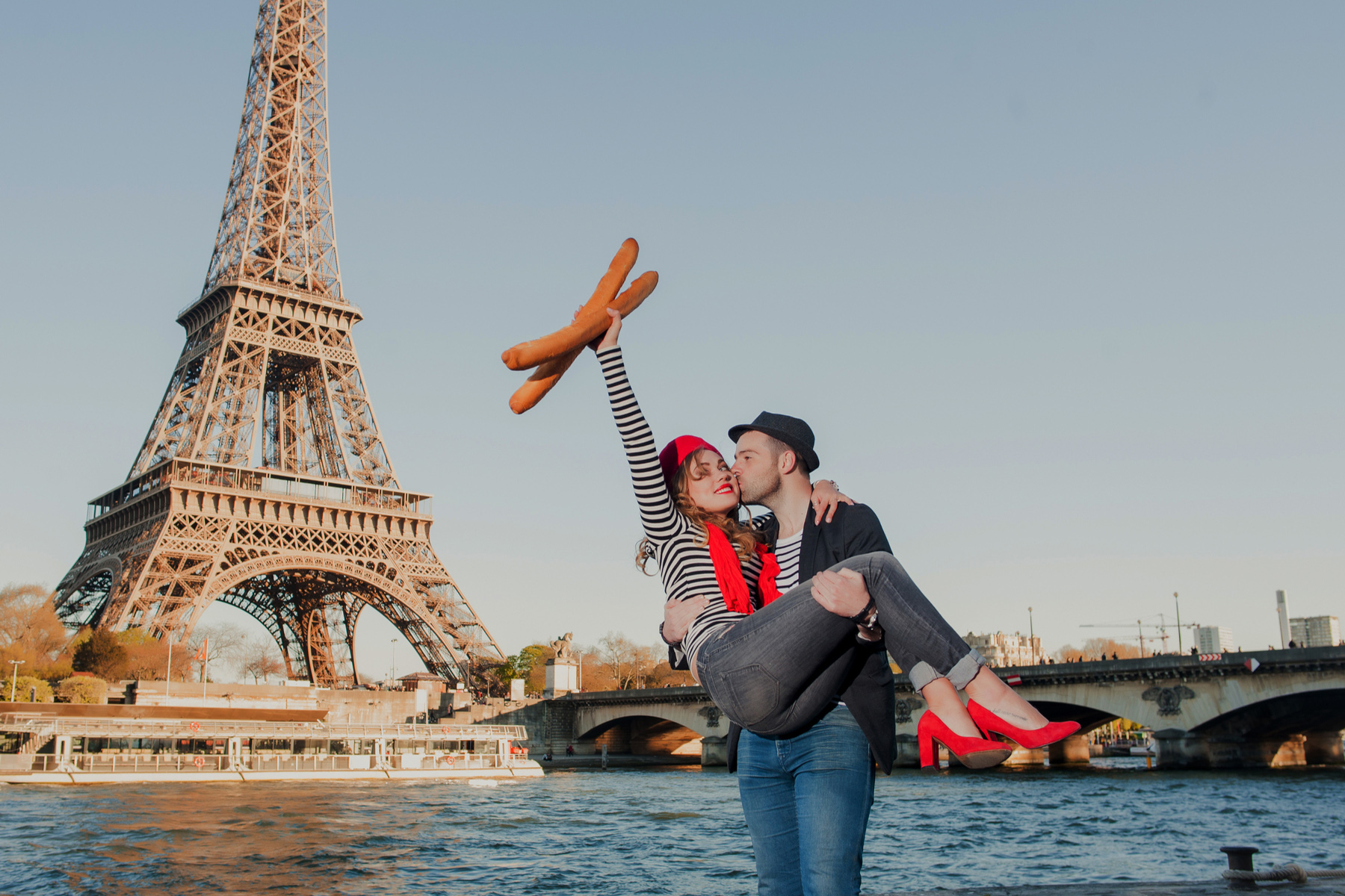 Couple with baguettes in Paris