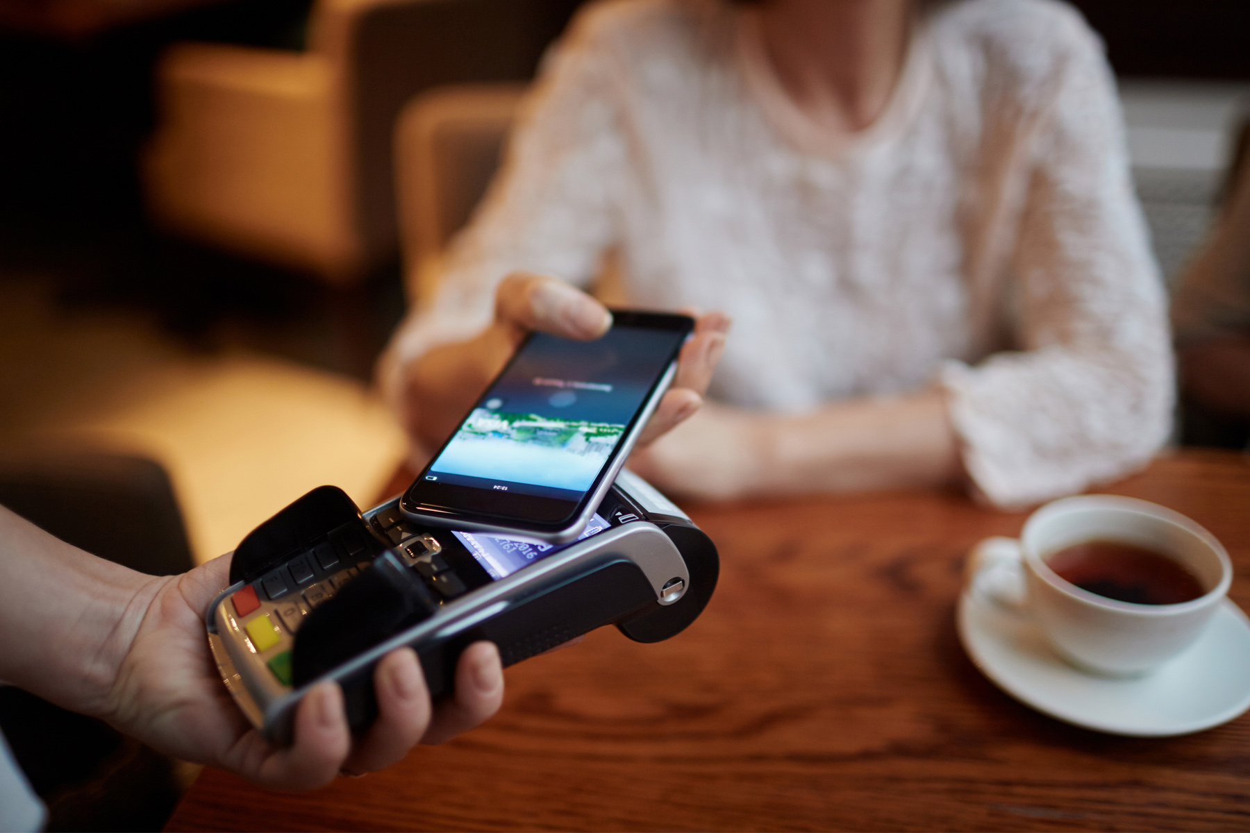 Customer using a mobile payment terminal