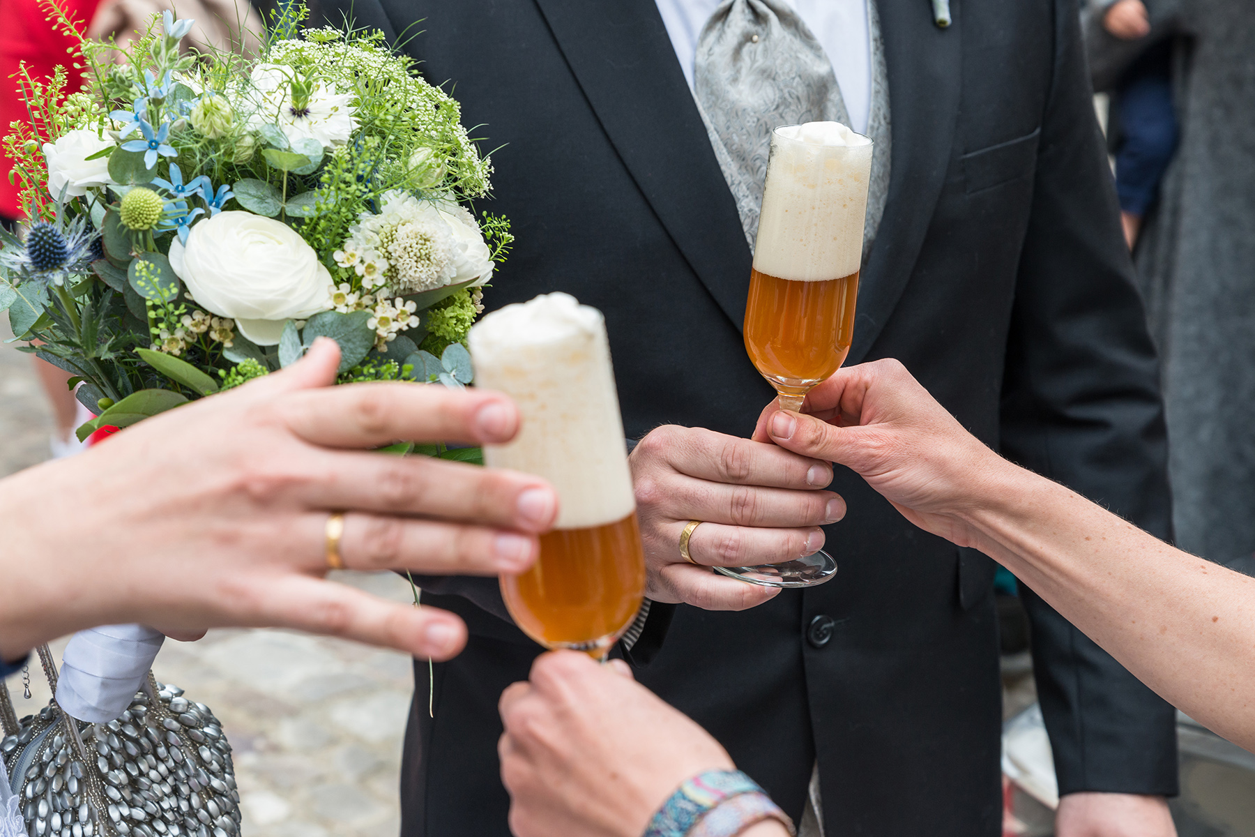 A wedded couple in Germany toasting with a beer