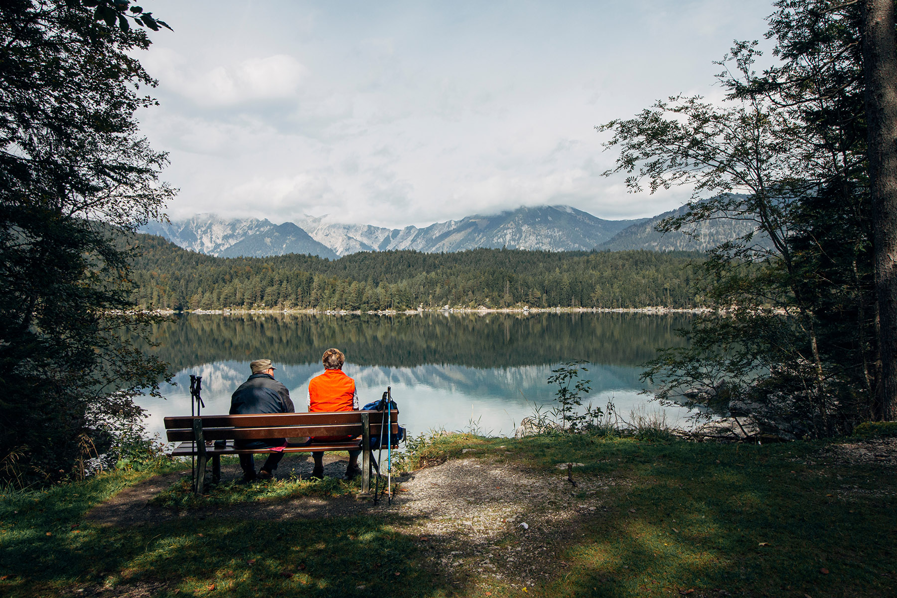 An elderly couple enjoys a view of the Eibsee
