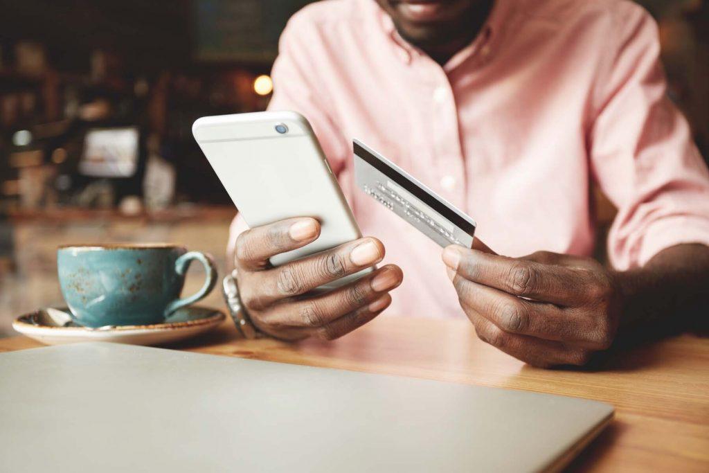 man paying bills on mobile