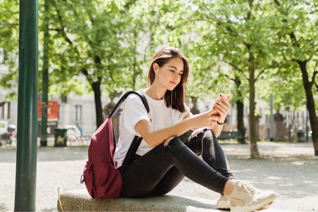 mobile operators in Luxembourg - girl sitting in park