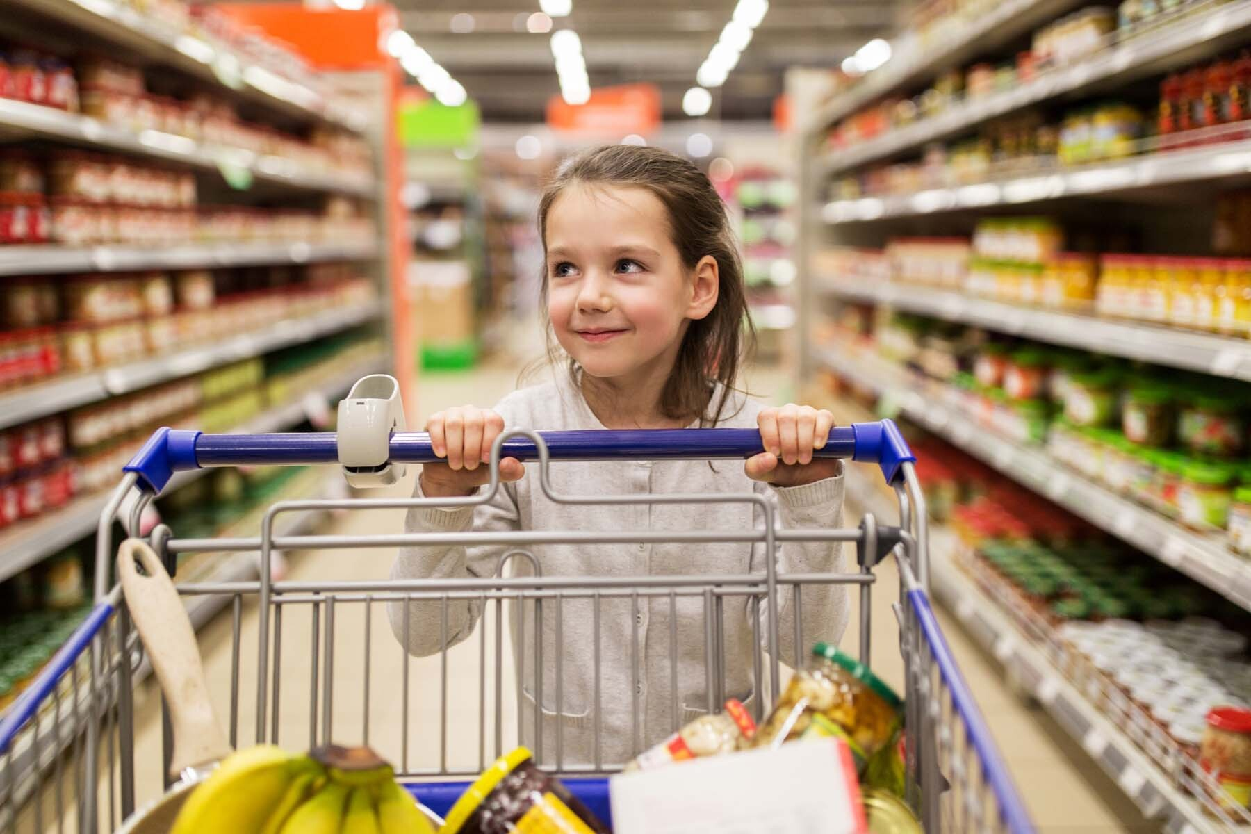 girl shopping in luxembourg supermarket