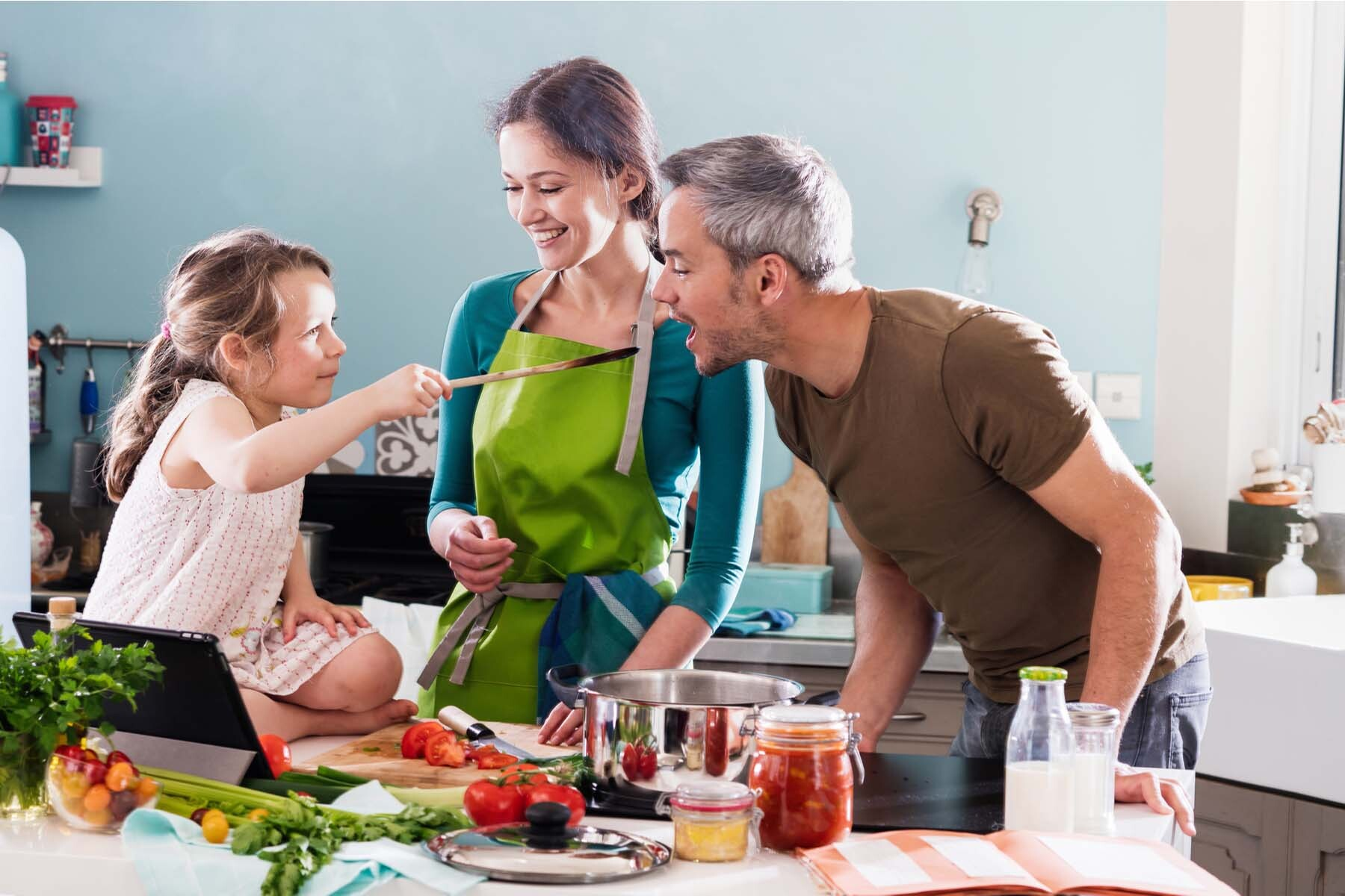 parents cooking with child