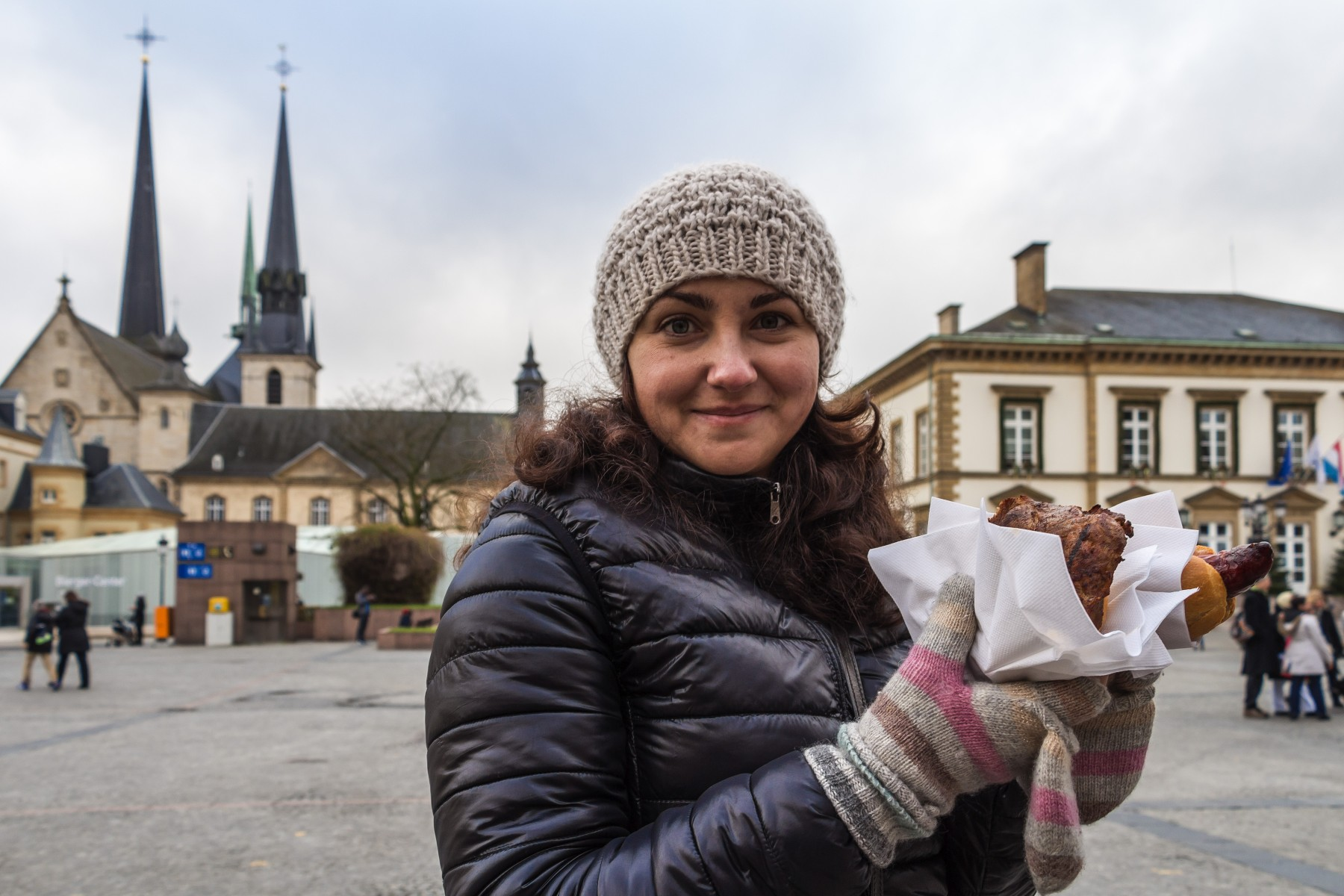 Woman with food at a Luxembourg Christmas market