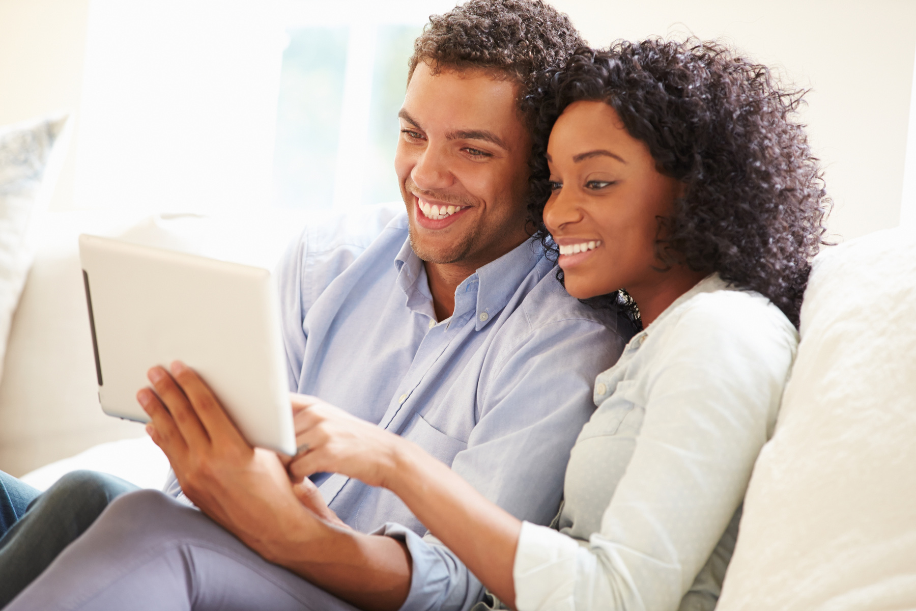 Couple reading a tablet together