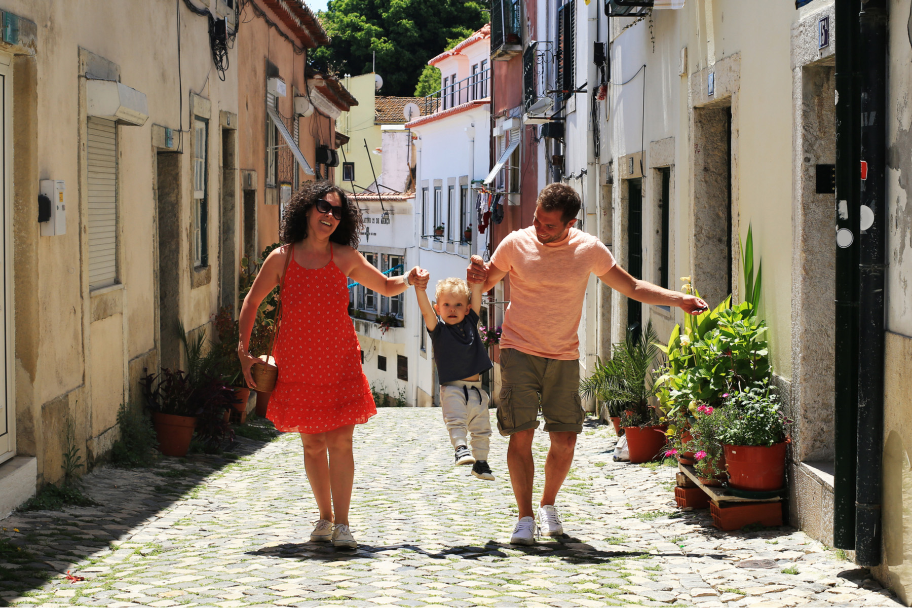 Family walking together in Lisbon