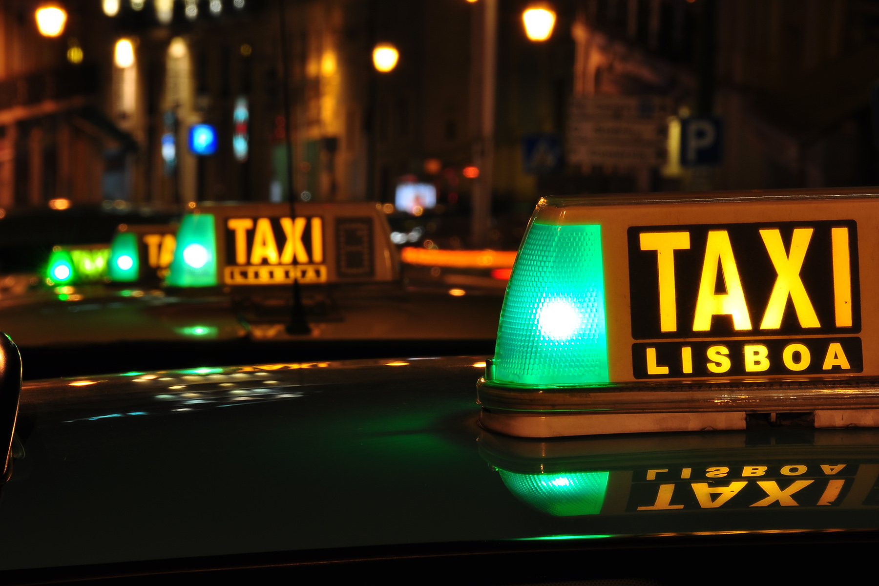 A Lisbon taxi stand at night