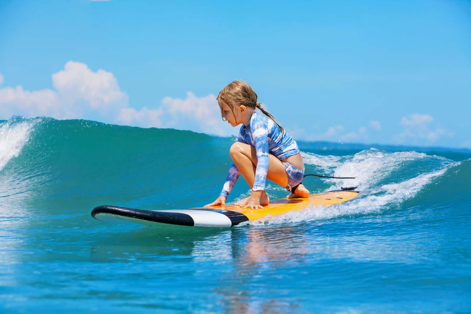 girl surfing in Portugal