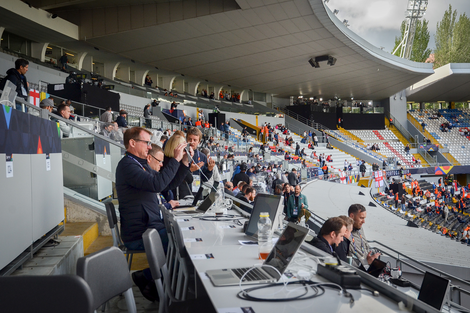 Freelance football journalists working at a match in Portugal