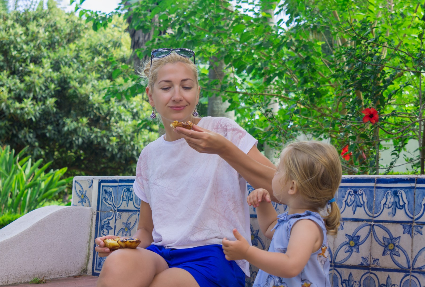 Portuguese cuisine, mother and daughter eating pastry