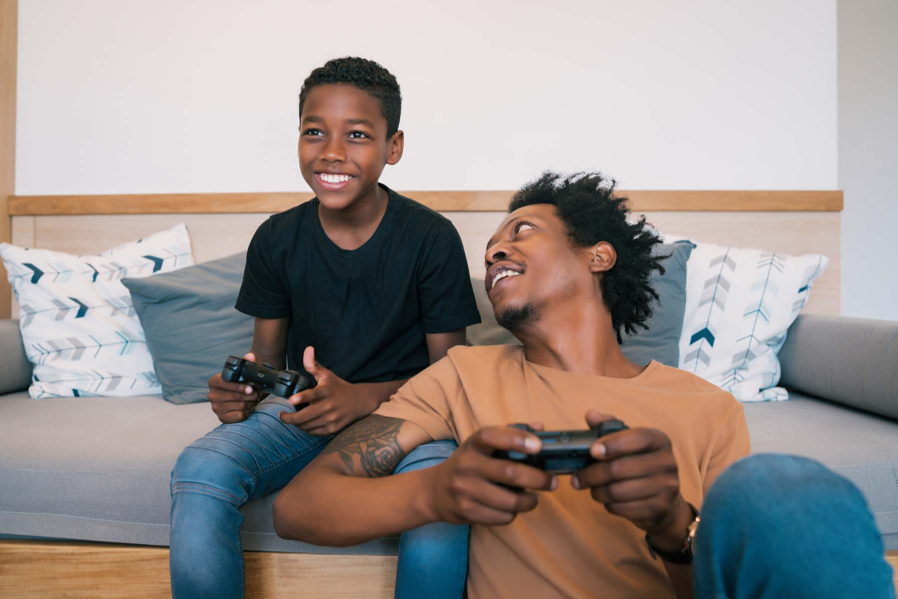 dad son playing video games