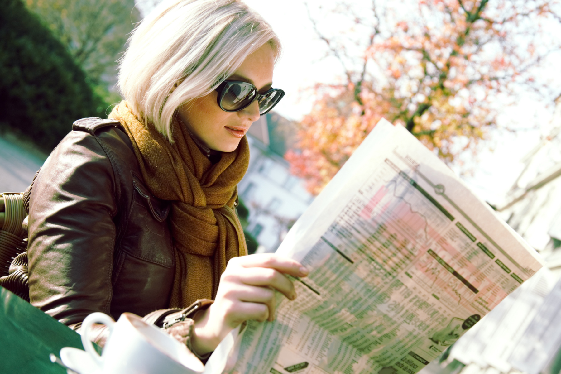 Woman reading a business newspaper