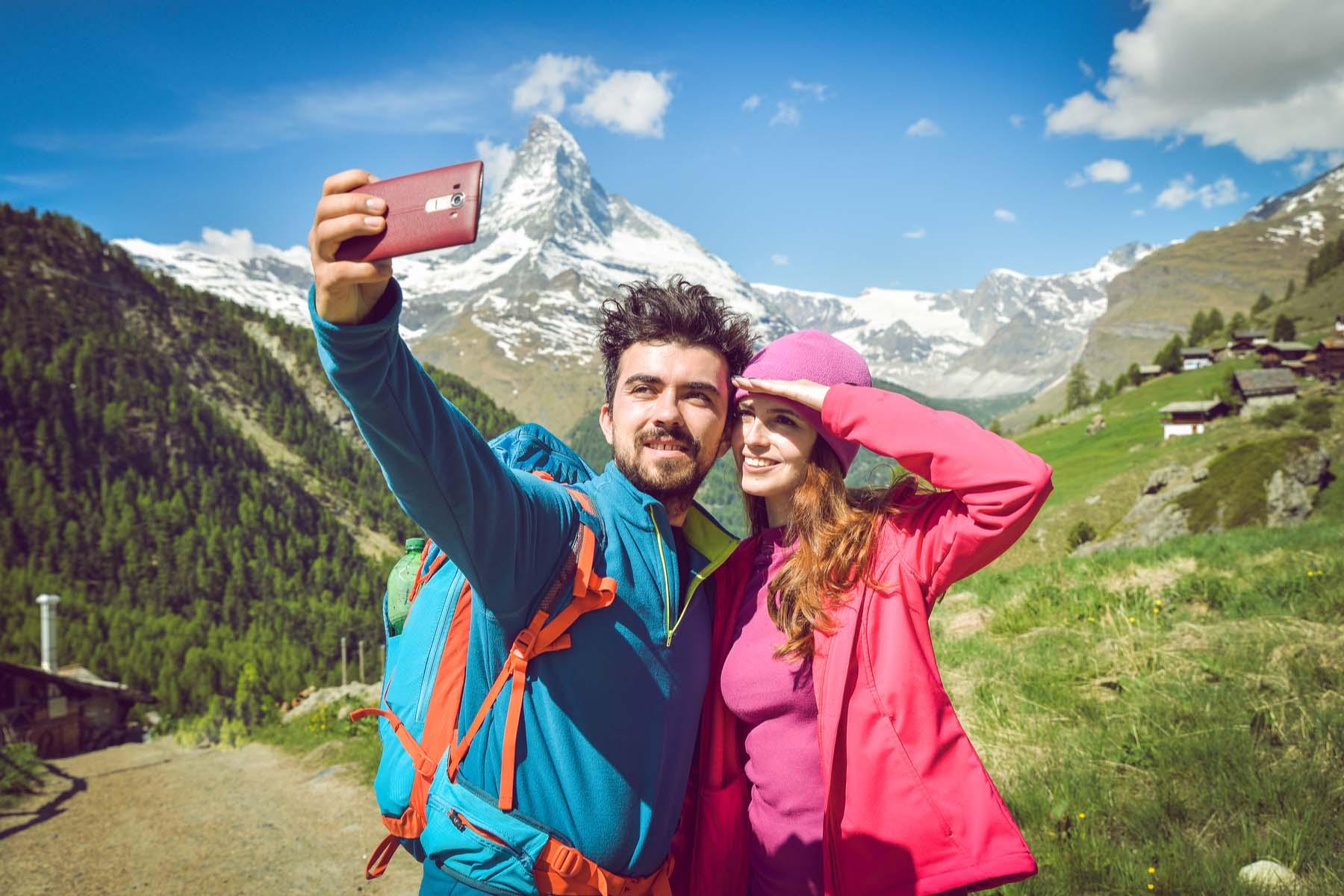 hikers using phone Switzerland
