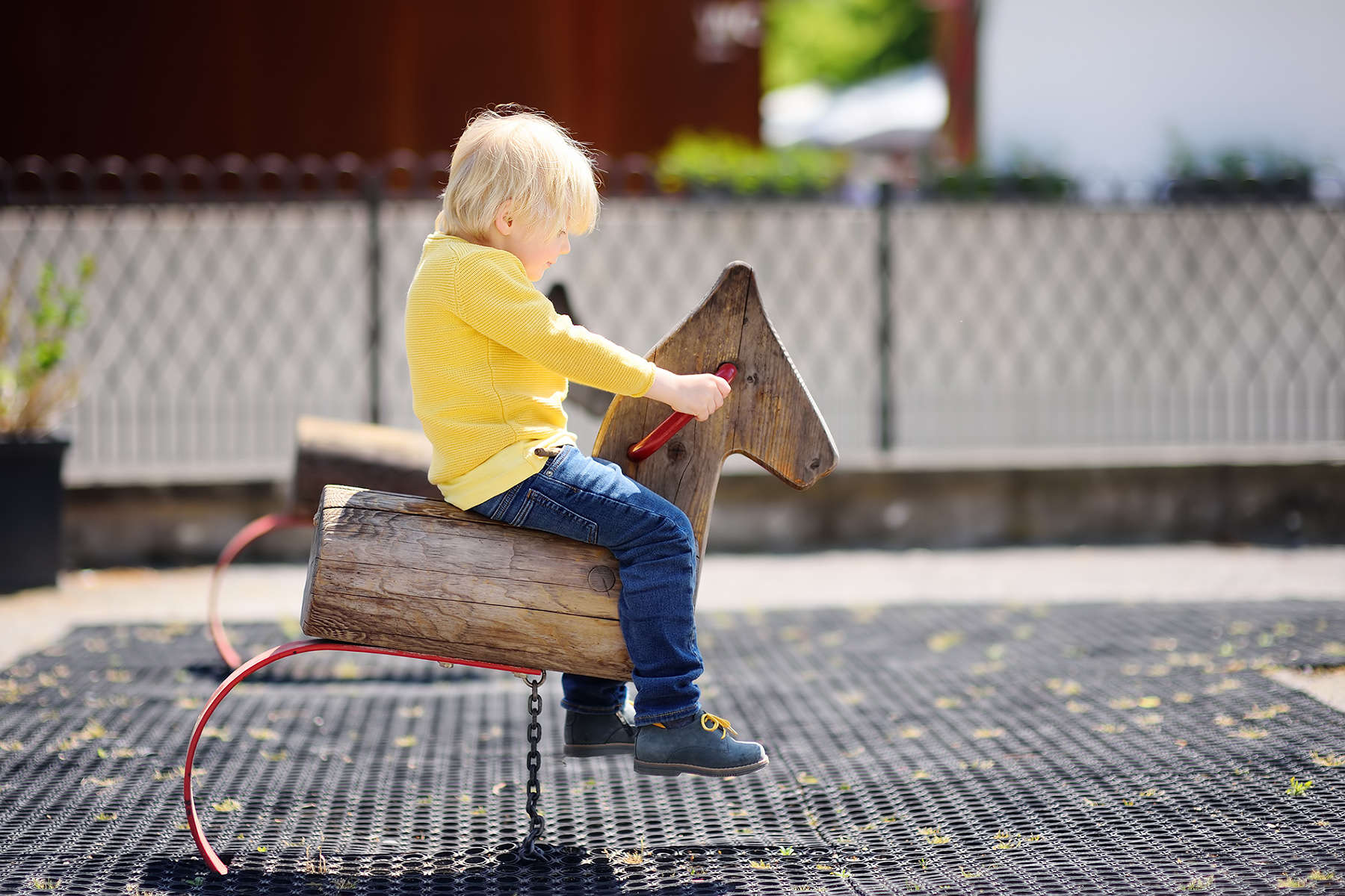 A child playing on a Swiss playground