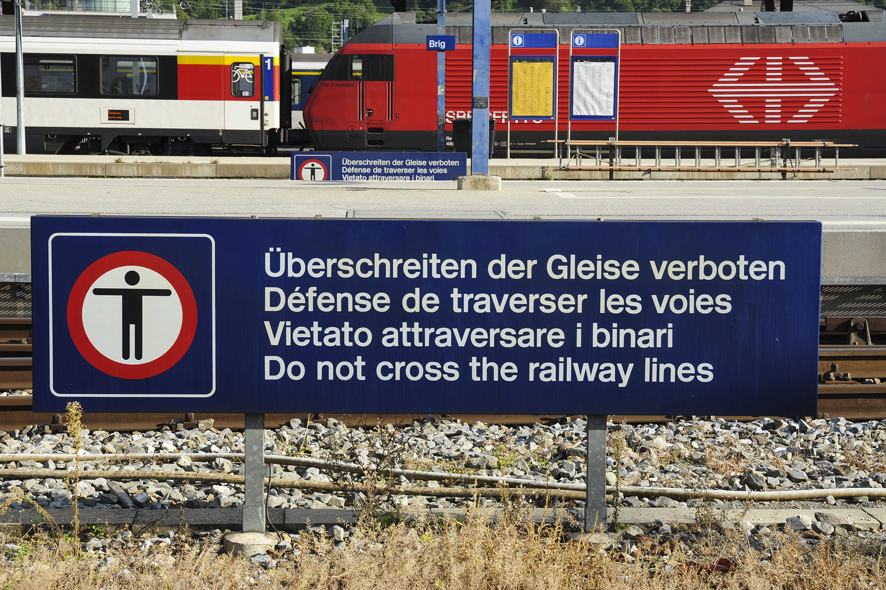 Multilingual sign at a train station in Switzerland