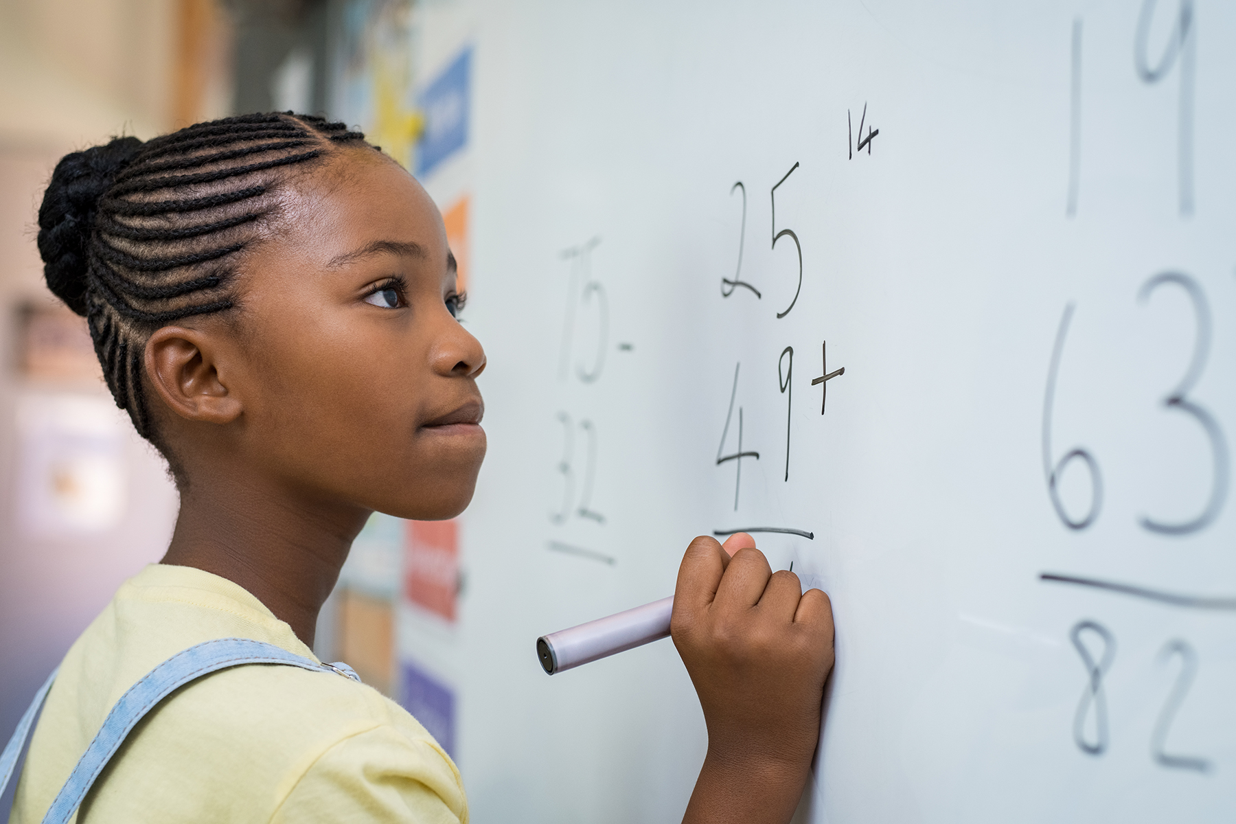 Student at whiteboard in Swiss boarding school