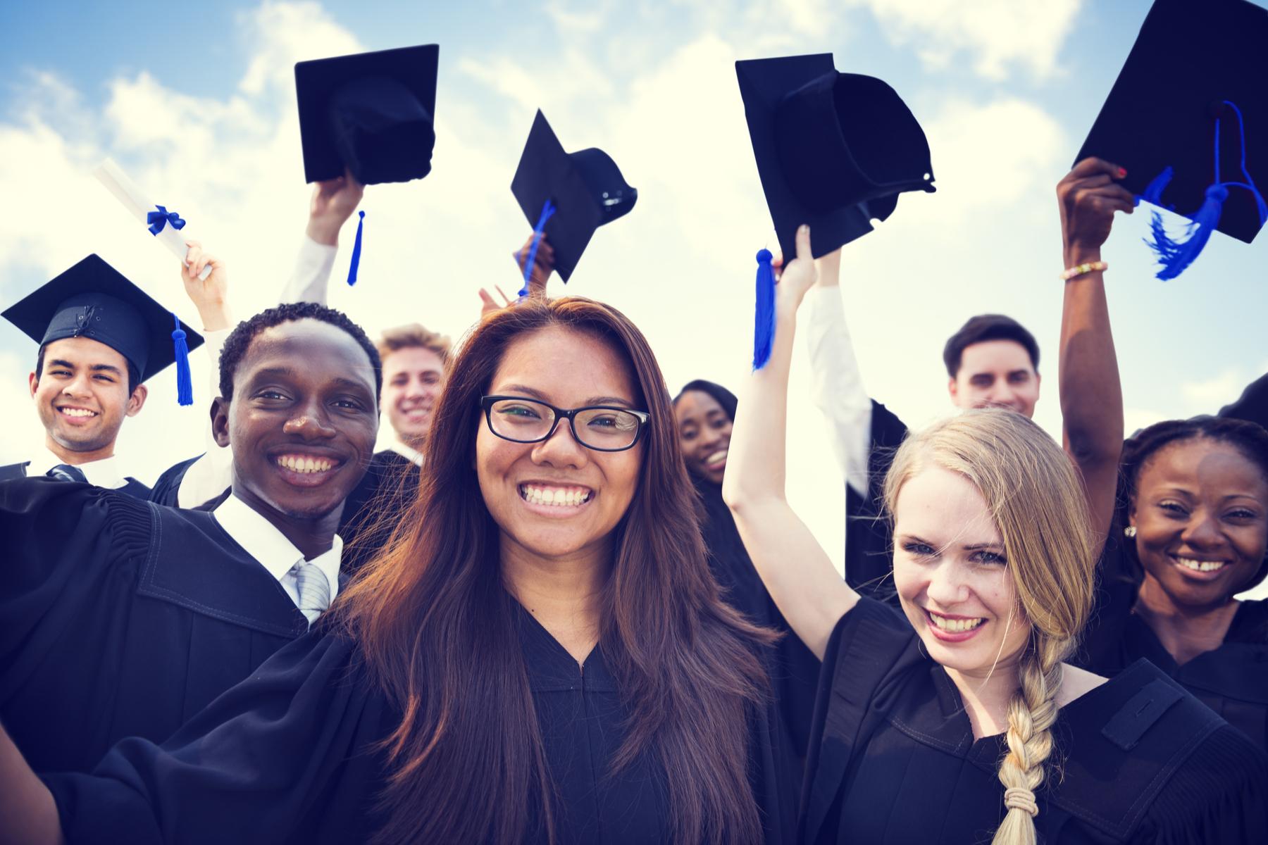 group of Swiss university students celebrating graduation