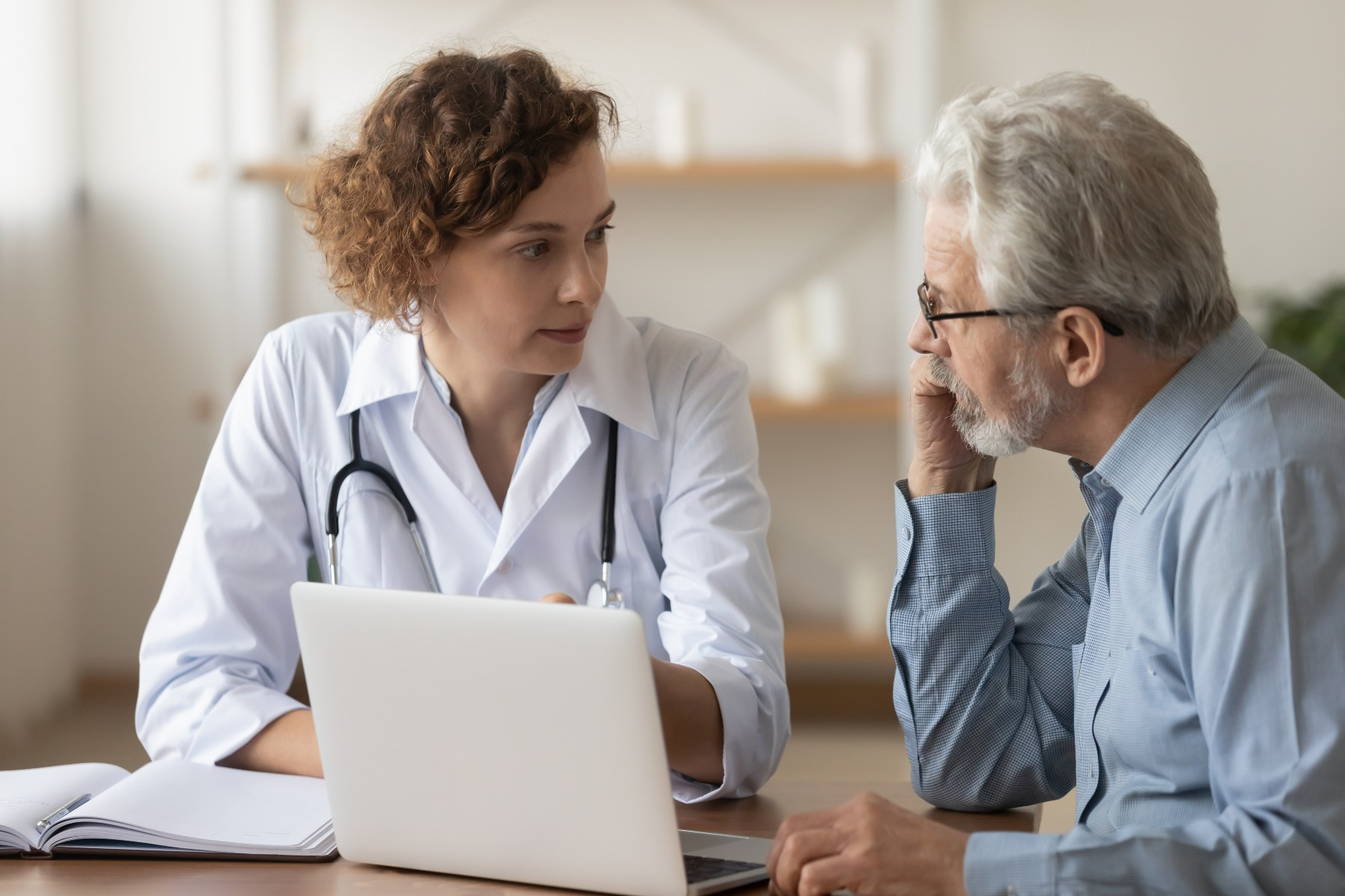 Swiss doctor talks with patient