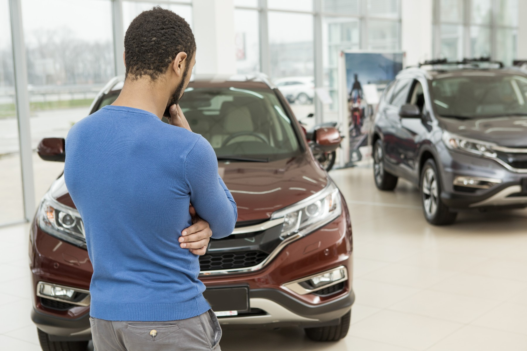 Man making decision on buying a car in Switzerland