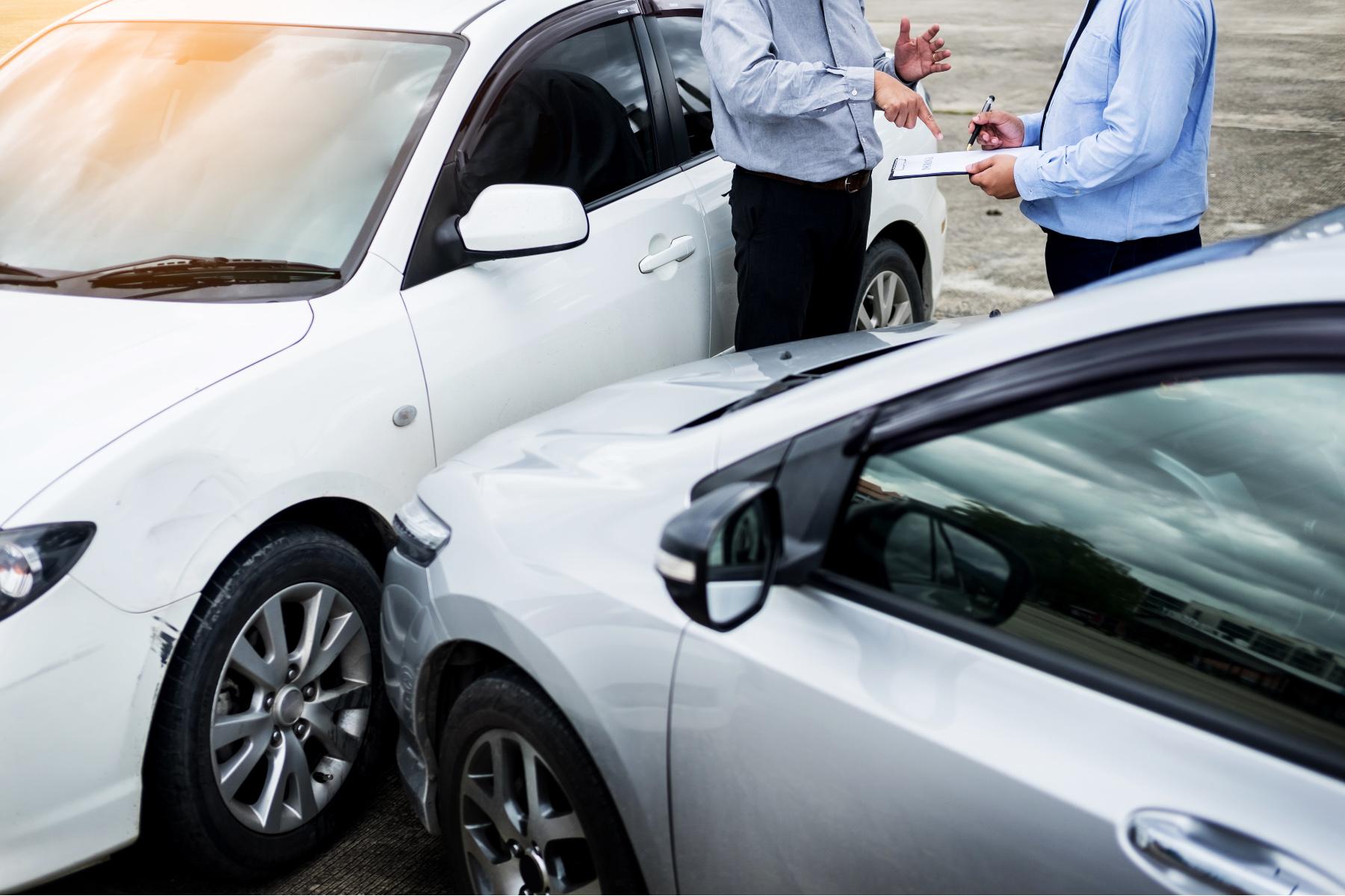 Drivers exchanging insurance details after a car crash