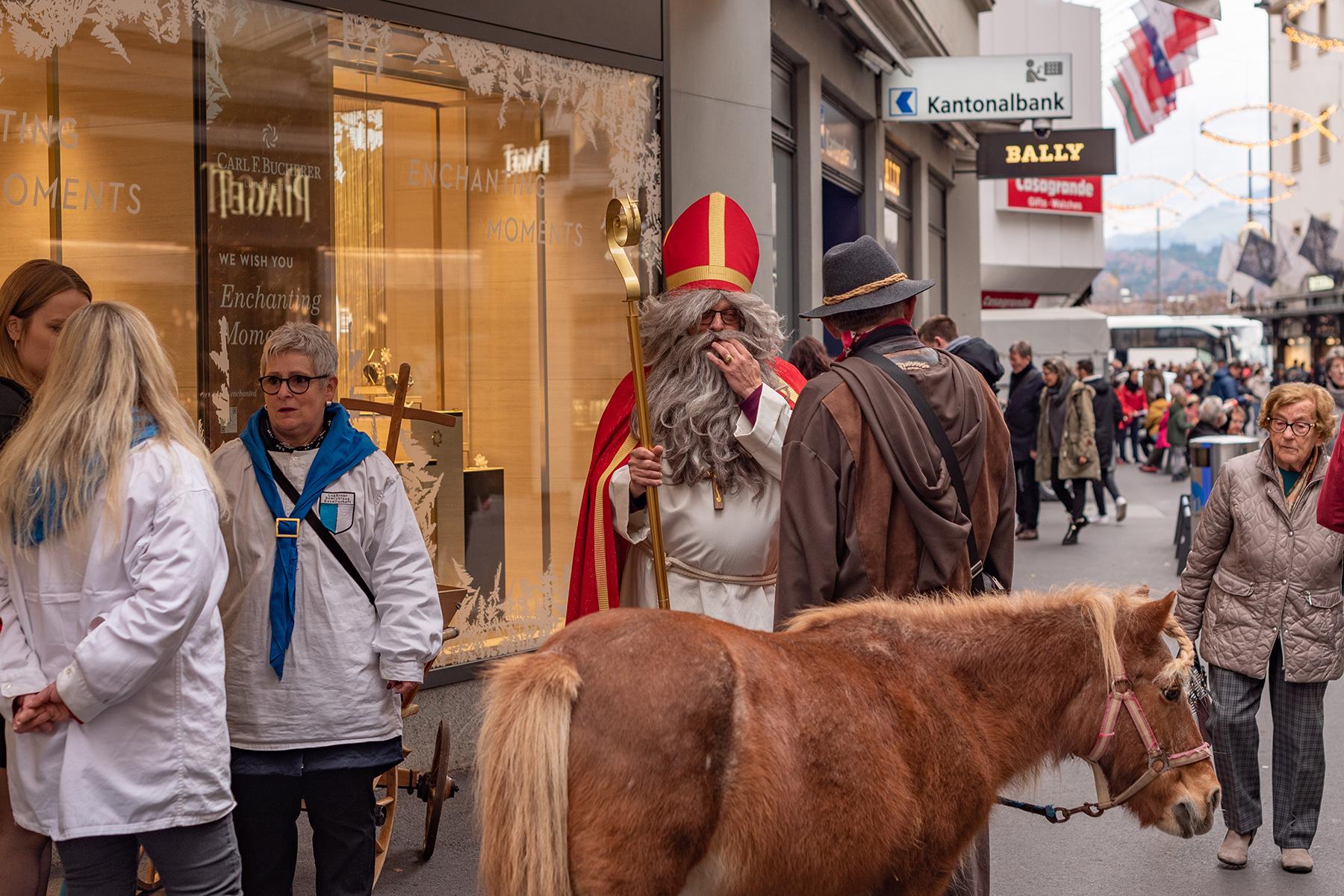 Samichlaus, Schmutzli, and their donkey in Luzern