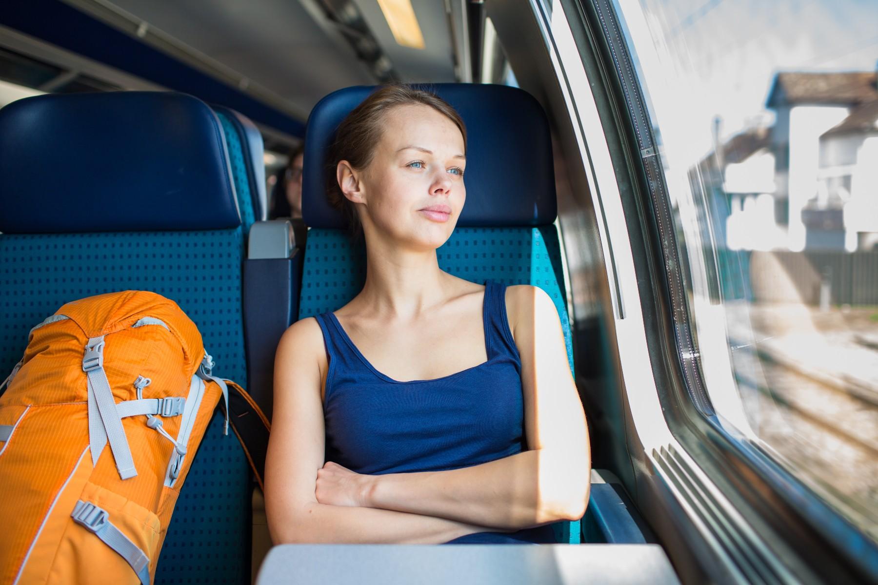 Switzerland holiday travel, woman on train