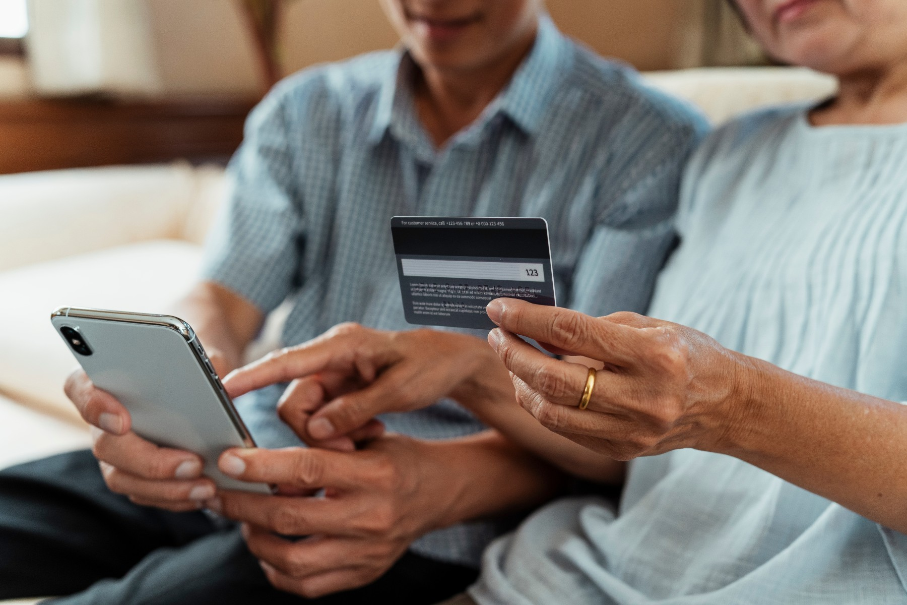 older couple transfer money with a traditional bank online