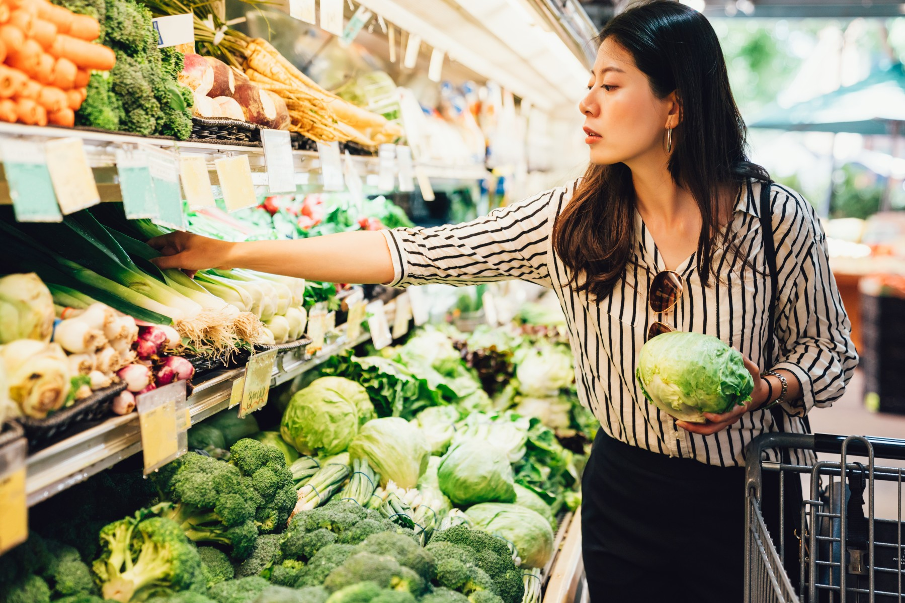 Swiss woman shopping for vegetables in the supermarket