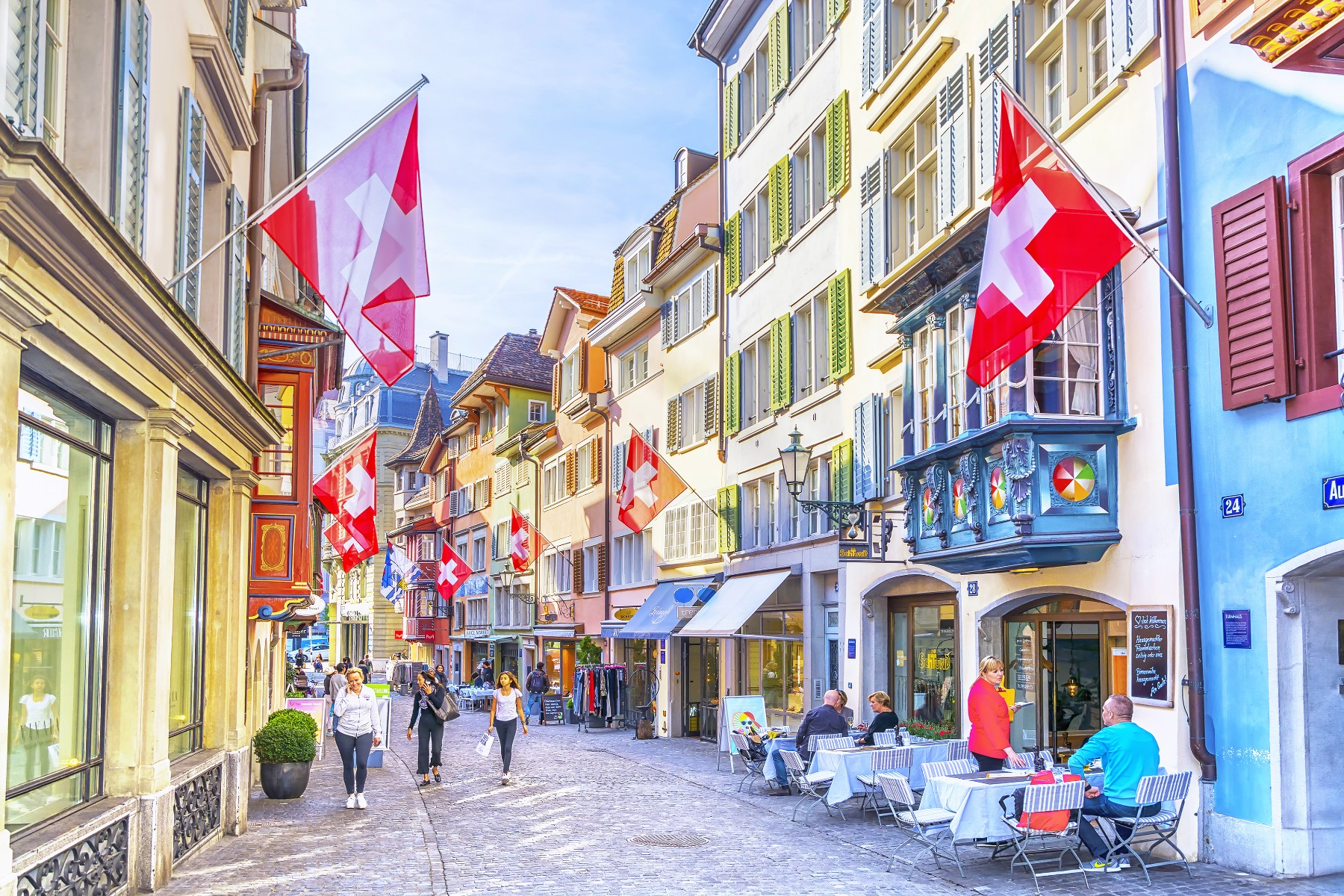 people walking and dining in Zurich's city center