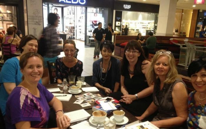 Women sitting having coffee