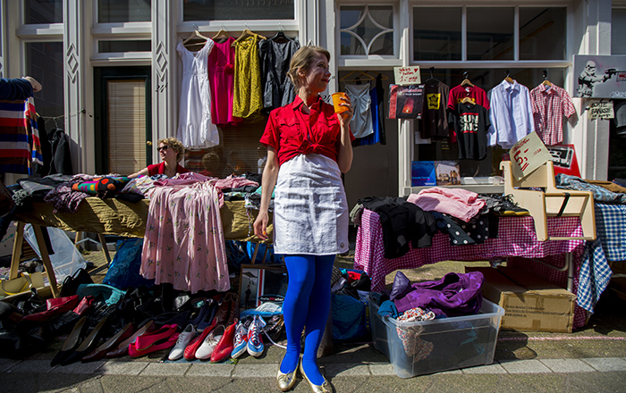 woman selling clothes on king's day