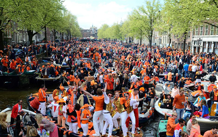 crowd celebrating King's day on boats